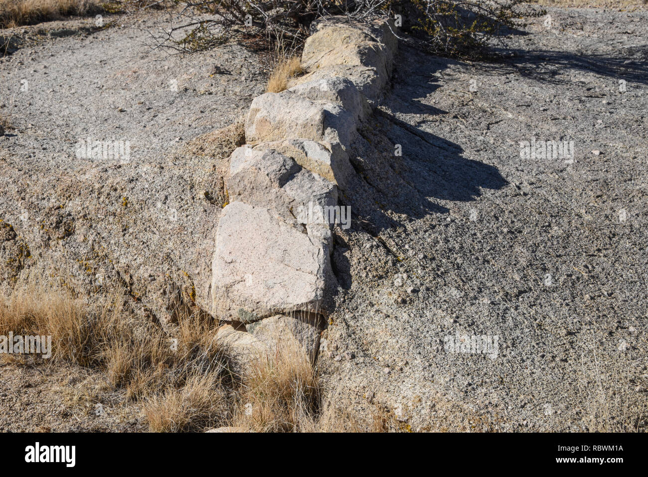 Geology formation of a dike of different rock inside a larger slab of rock - Stock Image