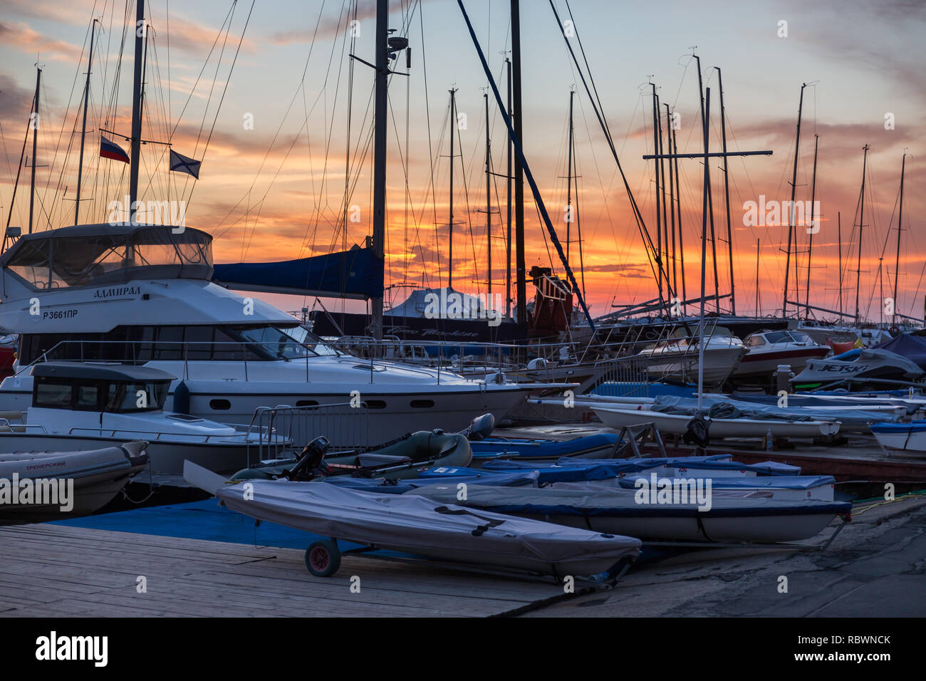 VLADIVOSTOK, RUSSIA - AUGUST, 2018: Sunset view of the yachts standing in harbour - Stock Image