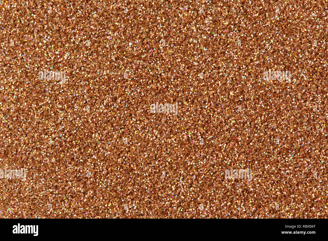 Brown glitter texture Christmas abstract background on macro - Stock Image