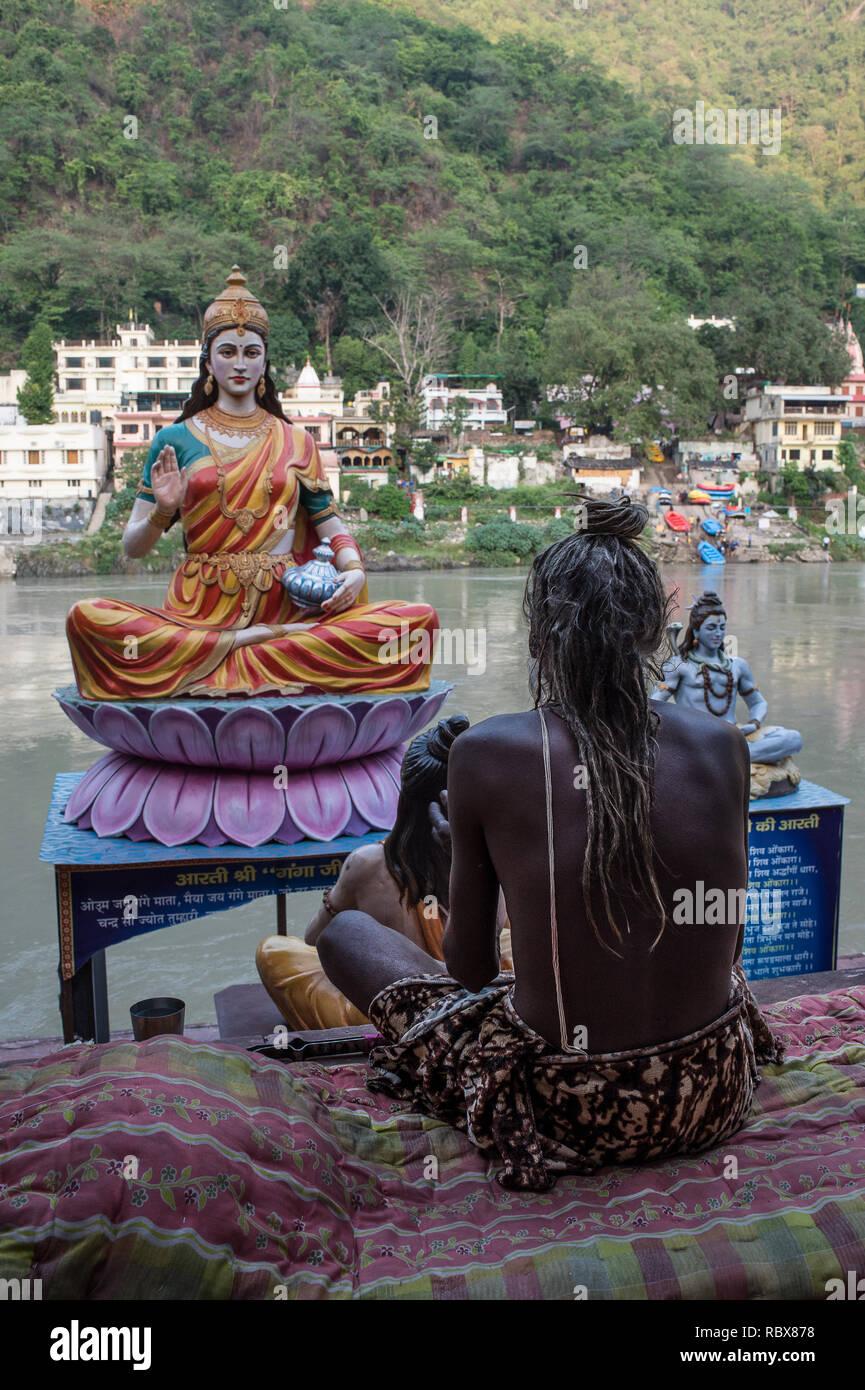 A sadhu (holy man) on the Rishikesh, India, Ganges Rive gaths - Stock Image