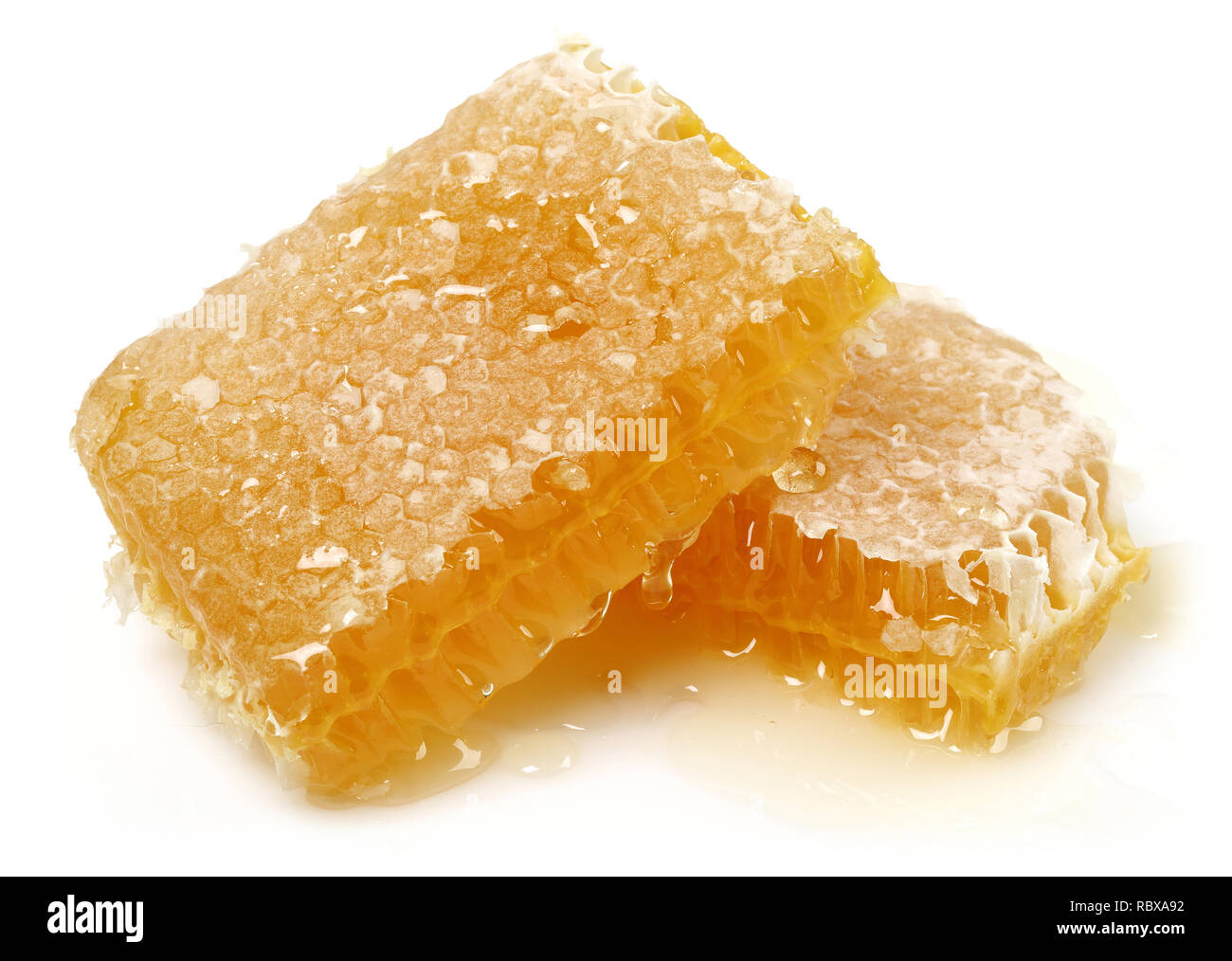 Honey with honeycomb isolated on white background - Stock Image