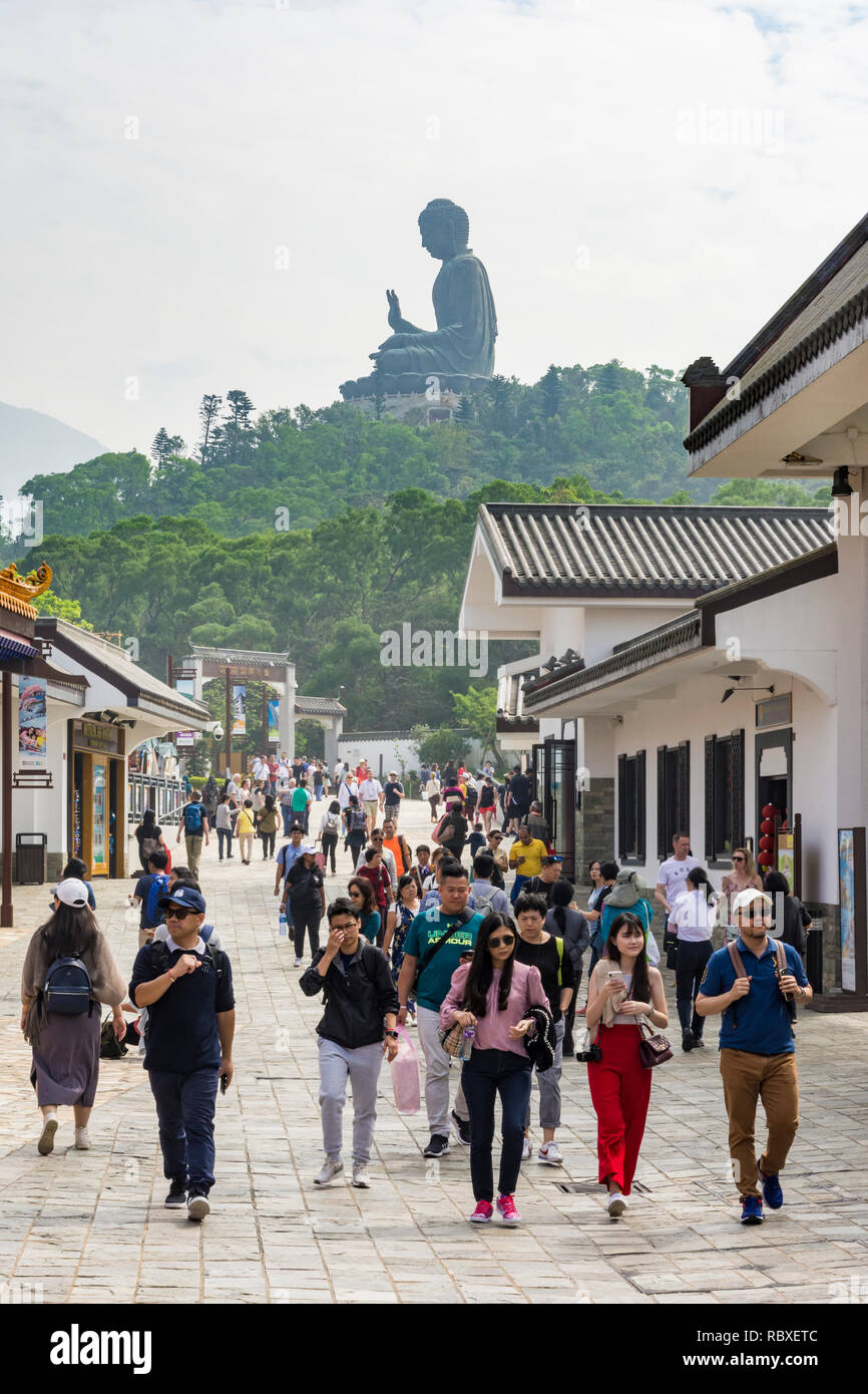 Ngong Ping village overlooked by the Tian Tan Buddha, Lantau Island, Hong Kong - Stock Image