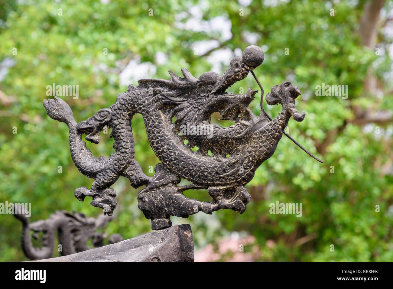 Rooftop detail of a dragon on a incense urn at the Po Lin Monastery, Lantau Island, Hong Kong - Stock Image