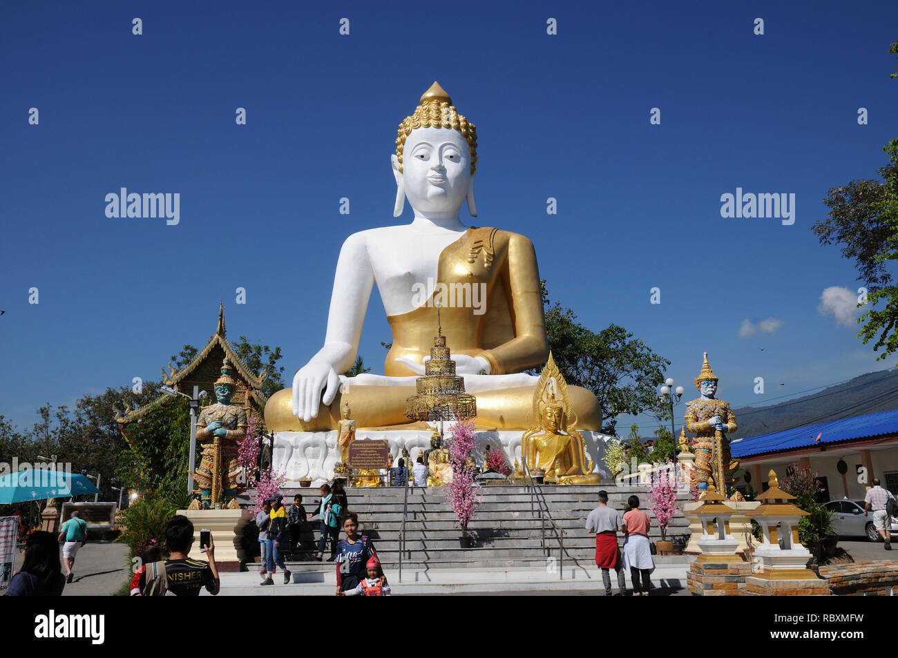 Giant statue of seated Buddha at Wat Phra That Doi Kham, Chiang Mai, Thailand Stock Photo
