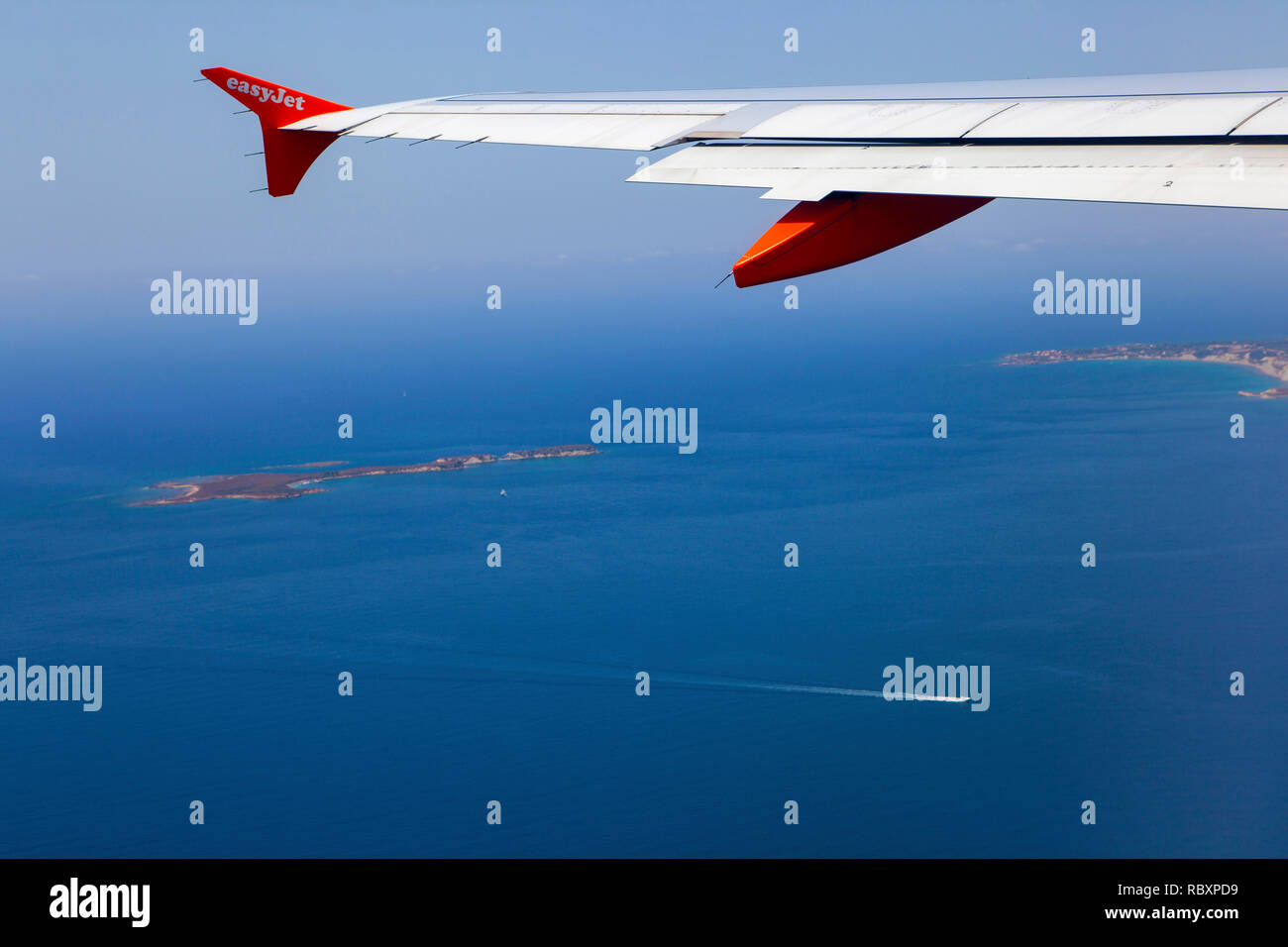 A view out of an Easyjet window, leaving Argostoli airport, Kefalonia looking down onto Vardiani island (or Rabbit Island) Stock Photo