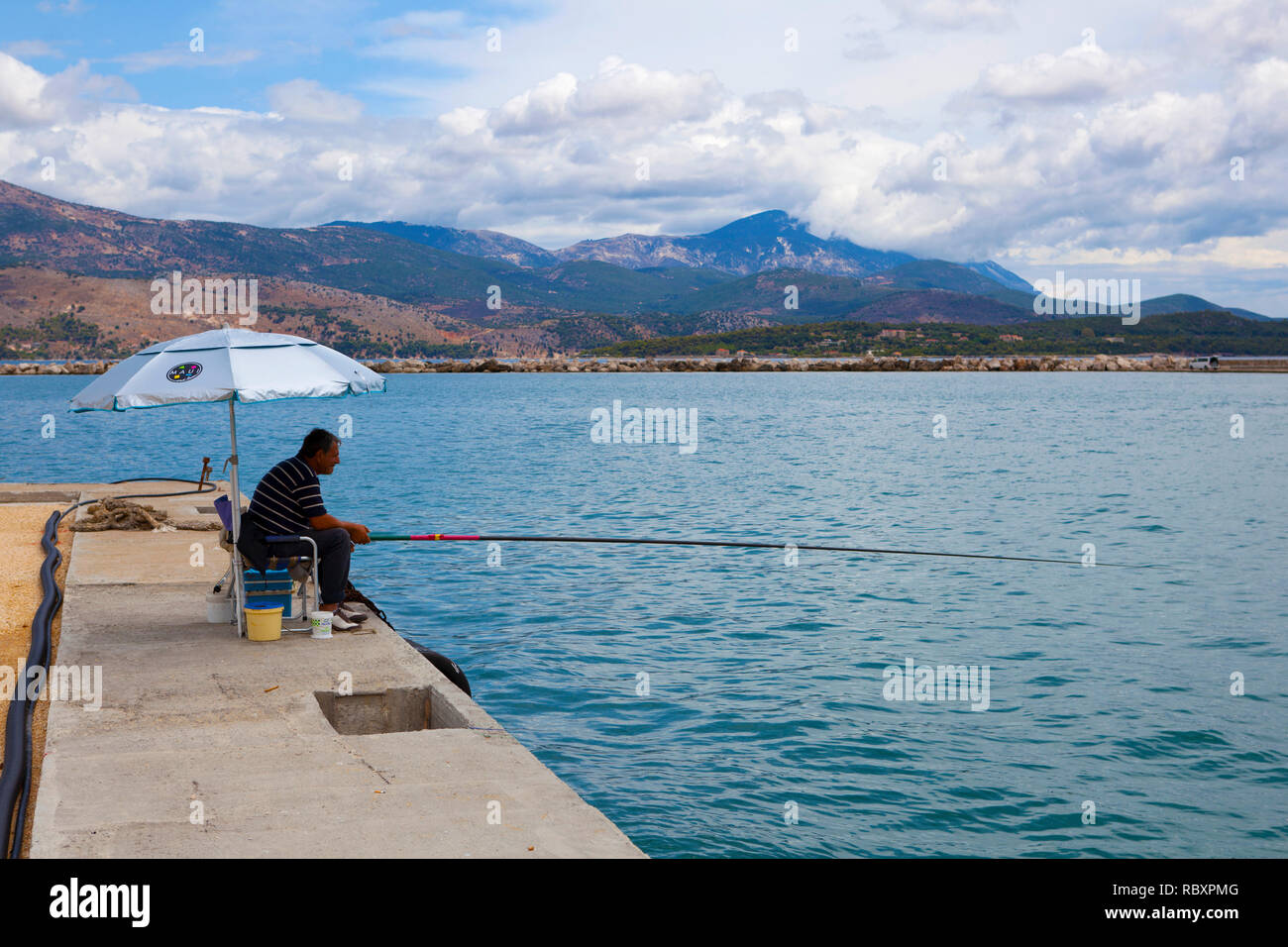 Greek angler at Lixouri, Kefalonia, Greece. - Stock Image