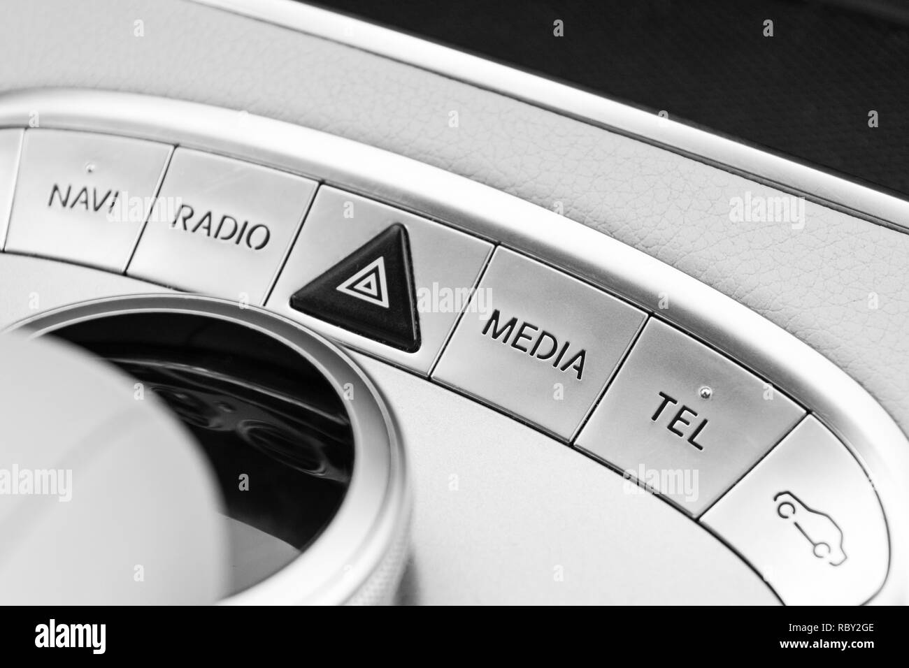 Media and navigation control buttons of a Modern car. Car interior details. White leather interior of the luxury modern car. Black and white - Stock Image