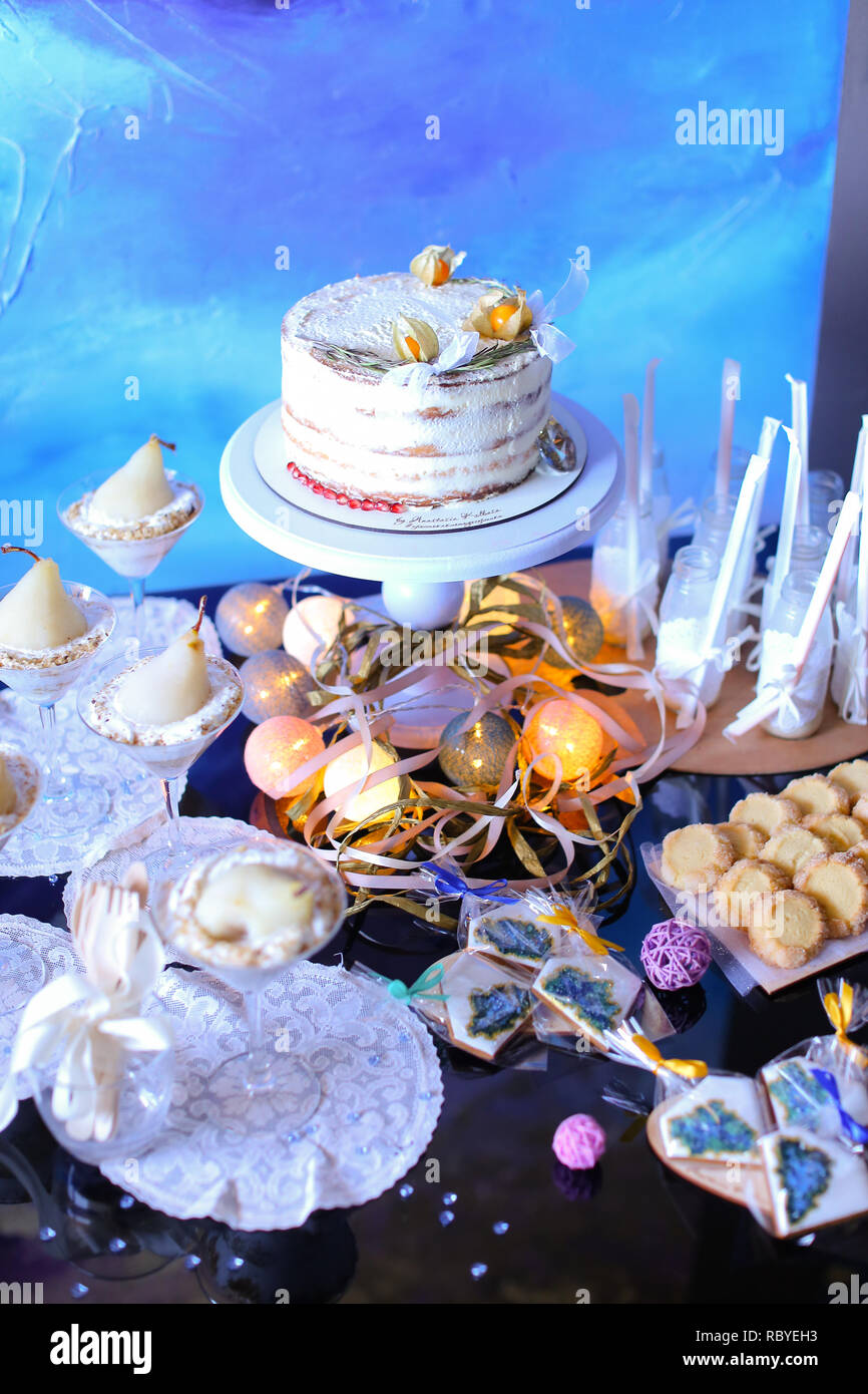 Birthday Cake And Yummy Sweets In Blue Background Garlands On Table Concept Of Homemade Dessert For Party Decorations Winter Holidays