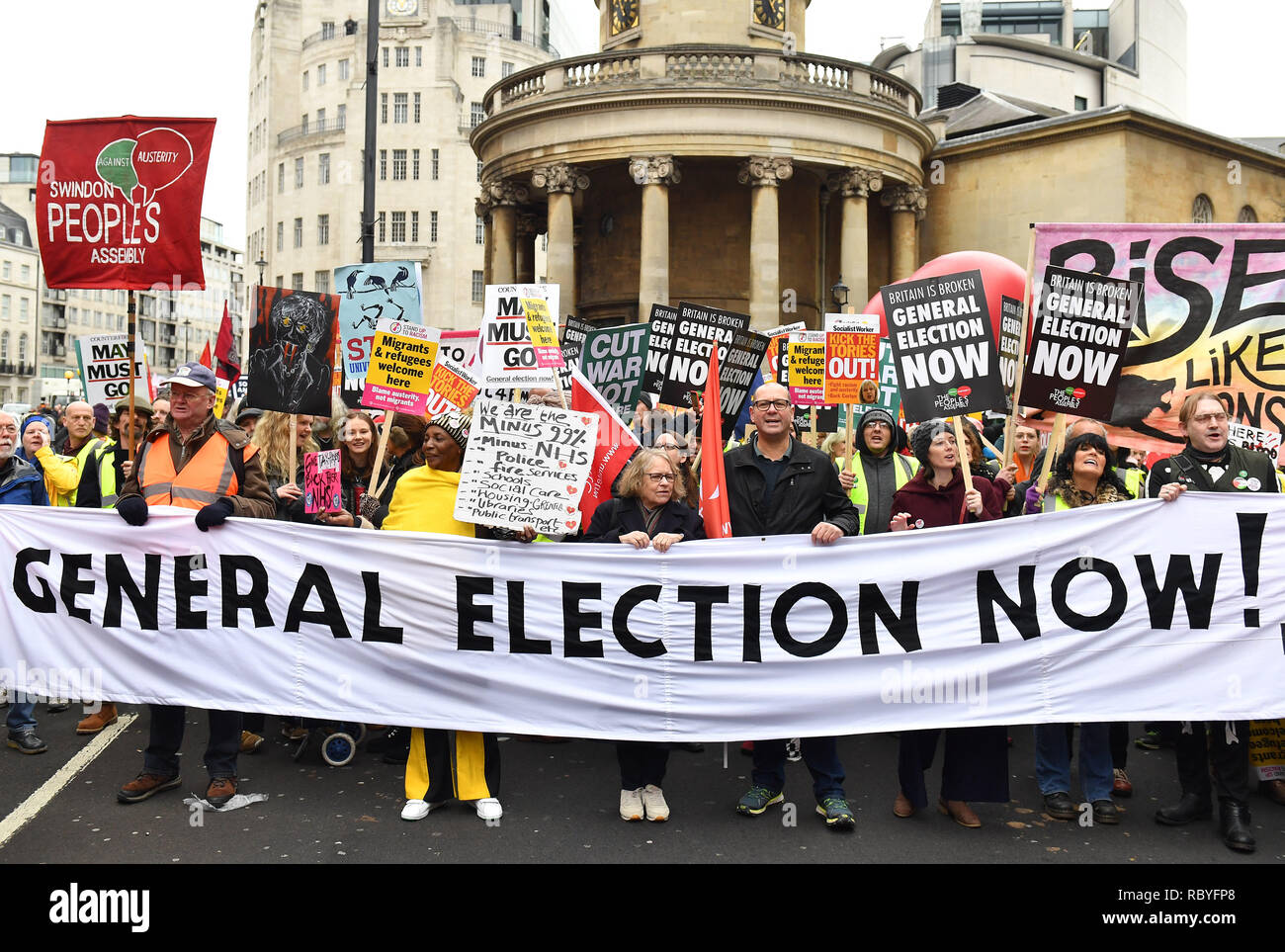 Demonstrators at a People's Assembly Against Austerity 'yellow vest'-inspired rally in central London calling for a general election. - Stock Image