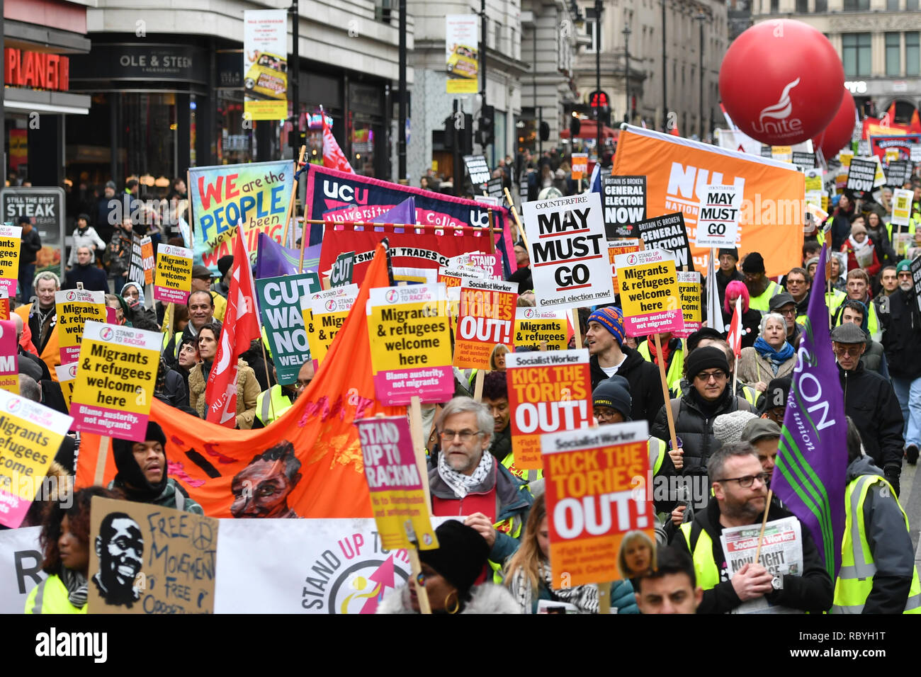 People's Assembly Against Austerity stage a 'yellow vest'-inspired rally in central London calling for a general election. - Stock Image