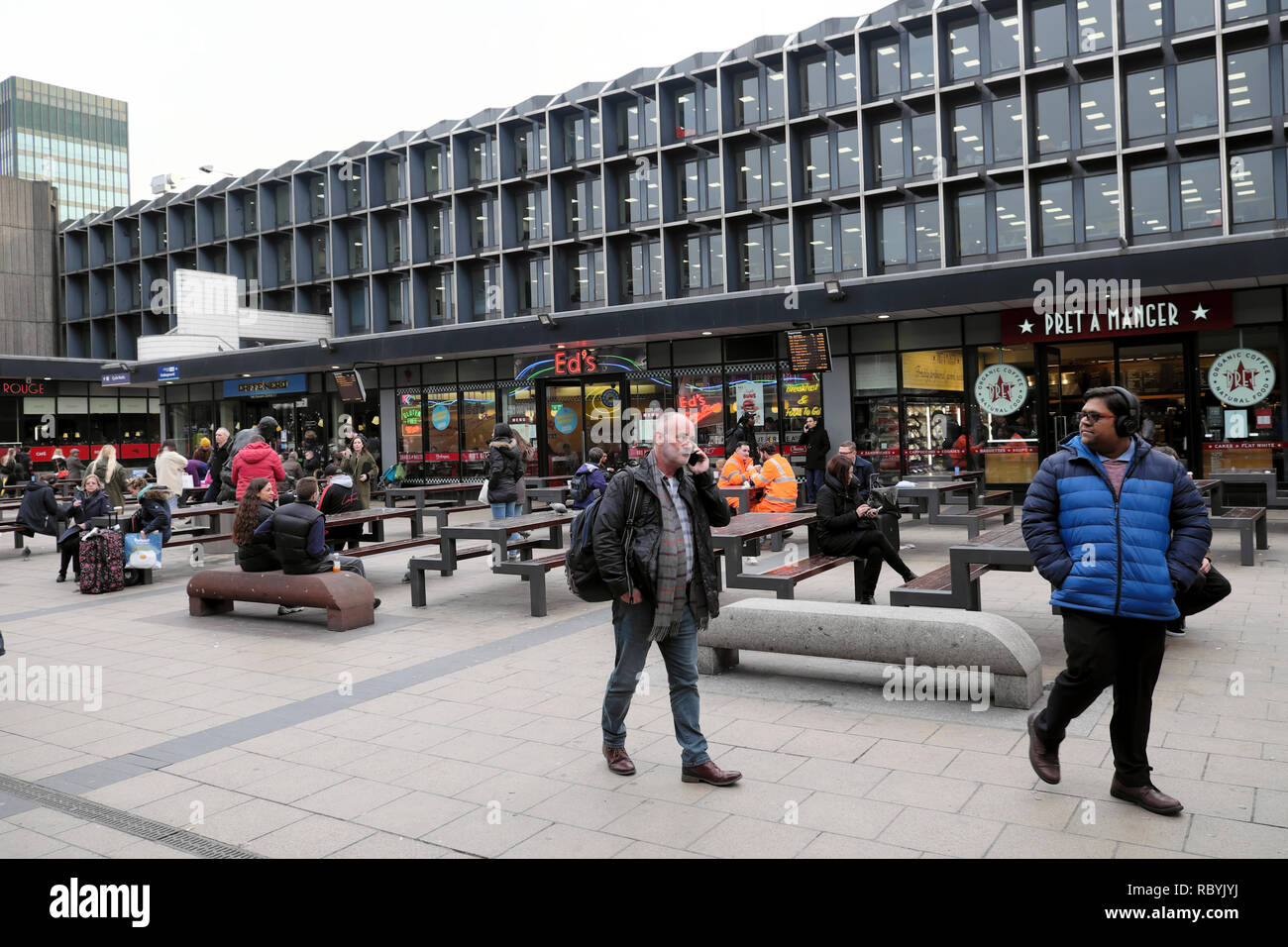 People and shops outside Euston Railway Station near Kings Cross in London UK  KATHY DEWITT - Stock Image