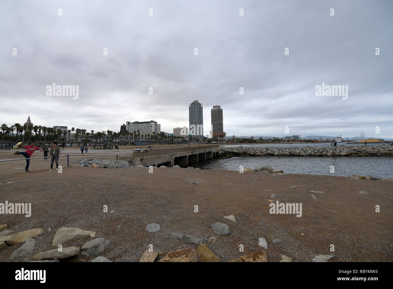 Barcelona, Spain. Barcelona's man-made beach is a destination even in bad weather. - Stock Image