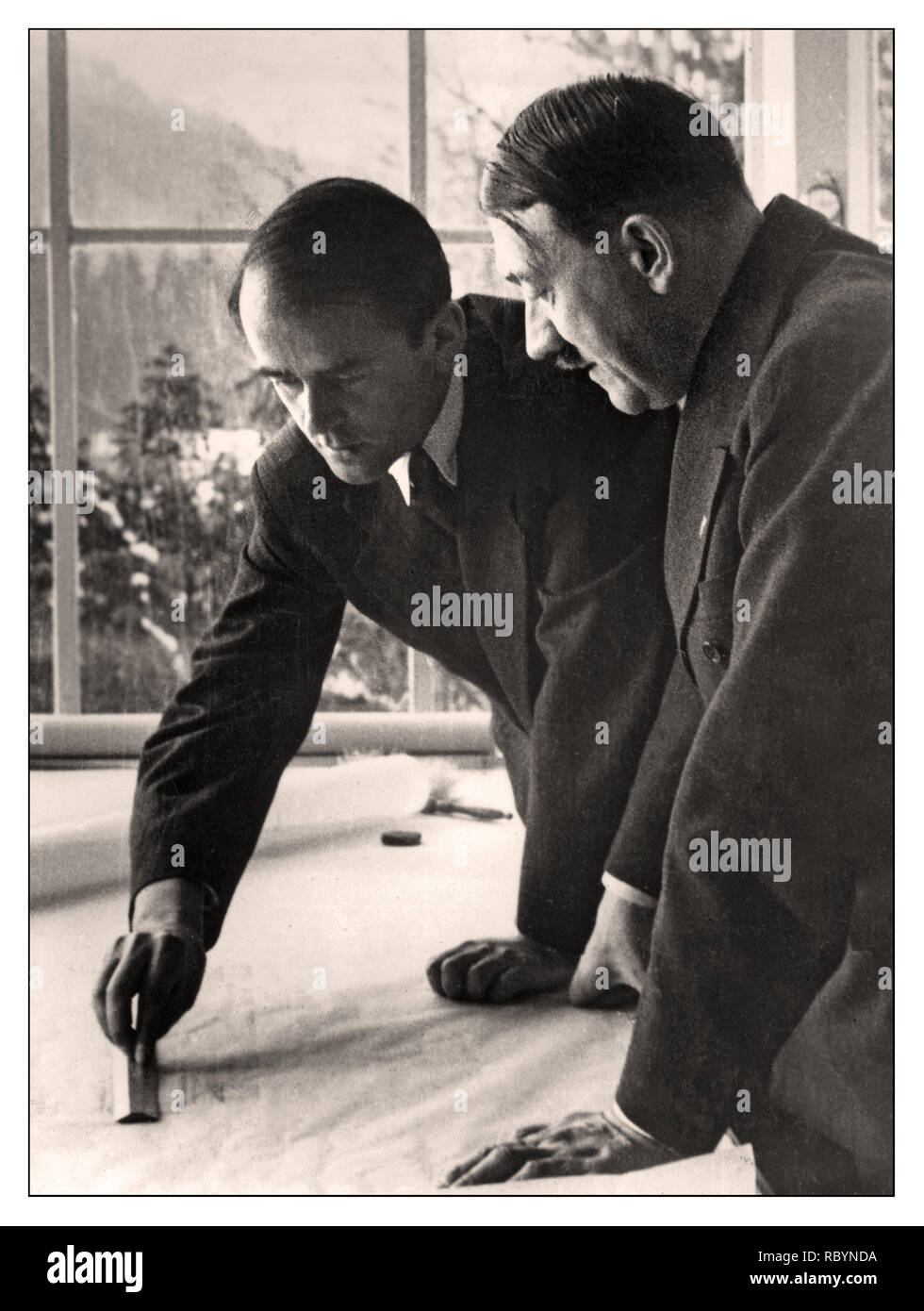 SPEER HITLER BERCHTESGADEN Archive pre-war image of Albert Speer presenting and dicussing an architectural drawing with German Nazi leader and Führer Adolf Hitler at Berchtesgaden, Bavaria, Germany, 1938 - Stock Image