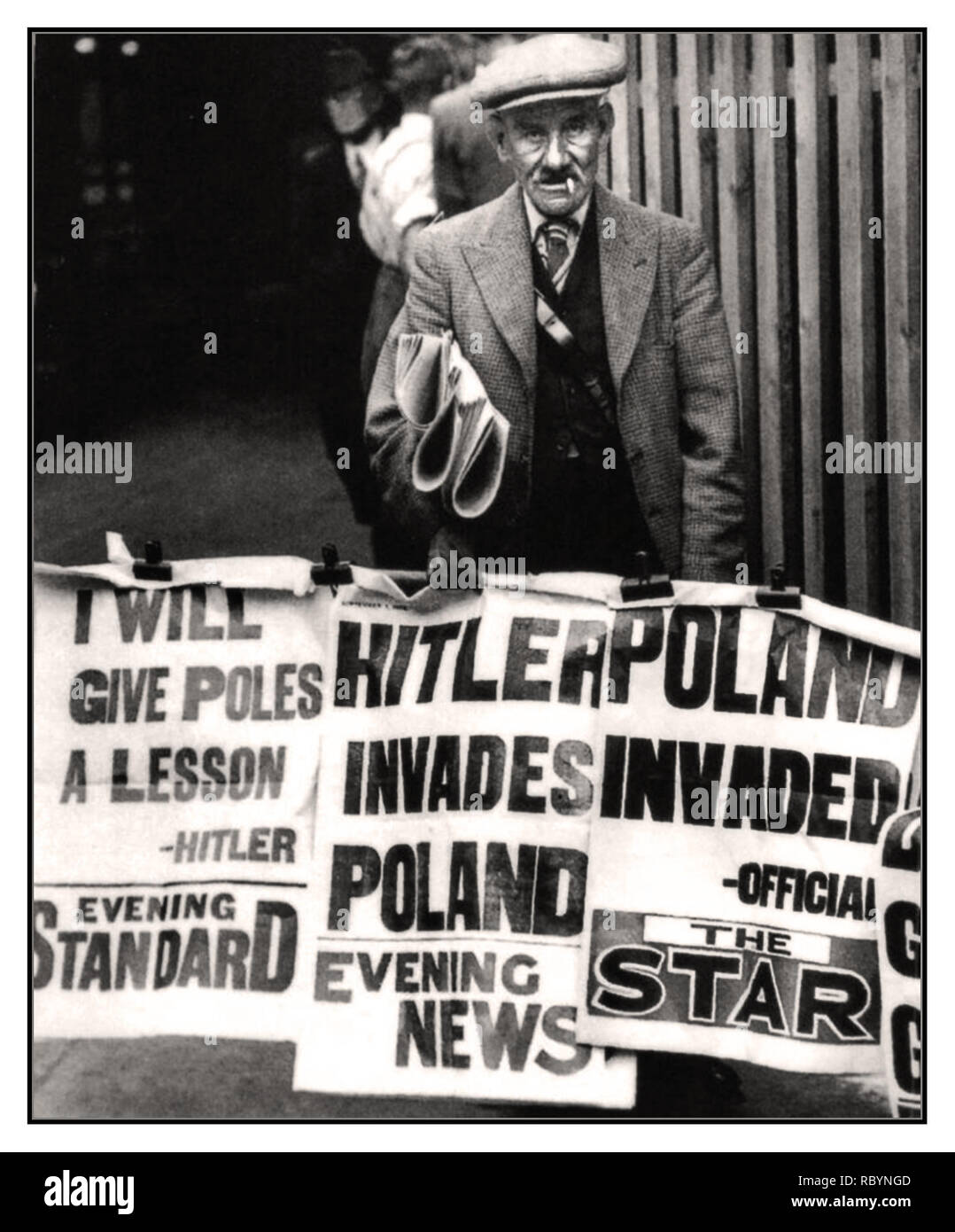 HITLER POLAND INVASION VINTAGE SEPTEMBER 1939 UK NEWSPAPERS HITLER INVADES POLAND  British newspaper seller and posters with news headlines that the Nazis have invaded Poland which started World War II.      Location: London, UK Date: September 1, 1939 Stock Photo