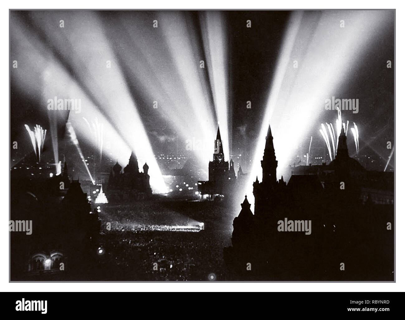 WW2 Hostilities end Nazi Germany defeated Moscow Red Square 1945 searchlights and fireworks in the sky signal the end of WW2 Celebrations in Moscow's Red Square, Soviet Union May 9, 1945 - Stock Image