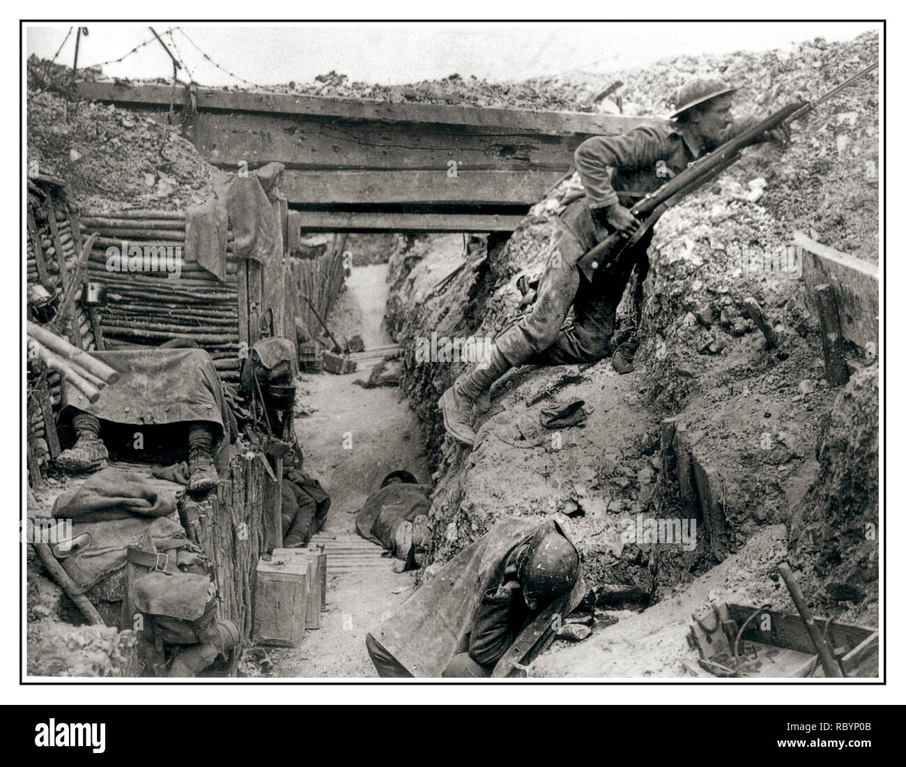 WW1 Battle of The Somme Trenches A German trench now occupied by British Soldiers resting during a lull in fighting near the Albert-Bapaume road at Ovillers-la-Boisselle, July 1916 during the Battle of the Somme. The men are from A Company, 11th Battalion, The Cheshire Regiment. Stock Photo
