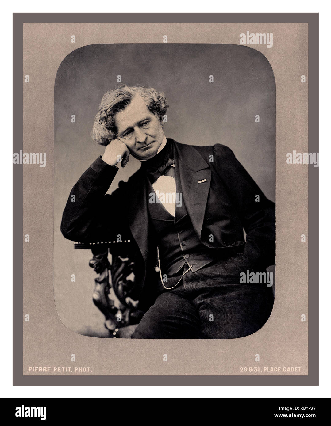 BERLIOZ FRENCH COMPOSER Vintage 1863 studio posed portrait of Louis-Hector Berlioz by Pierre Petit, Place Cadet Paris France   11 December 1803 – 8 March 1869) He was a French Romantic composer. His output includes orchestral works such as the Symphonie fantastique and Harold in Italy, choral pieces including the Requiem and L'enfance du Christ, his three operas Benvenuto Cellini, Les Troyens and Béatrice et Bénédict, and works of hybrid genres such as the 'dramatic symphony' Roméo et Juliette and the 'dramatic legend' La damnation de Faust. - Stock Image