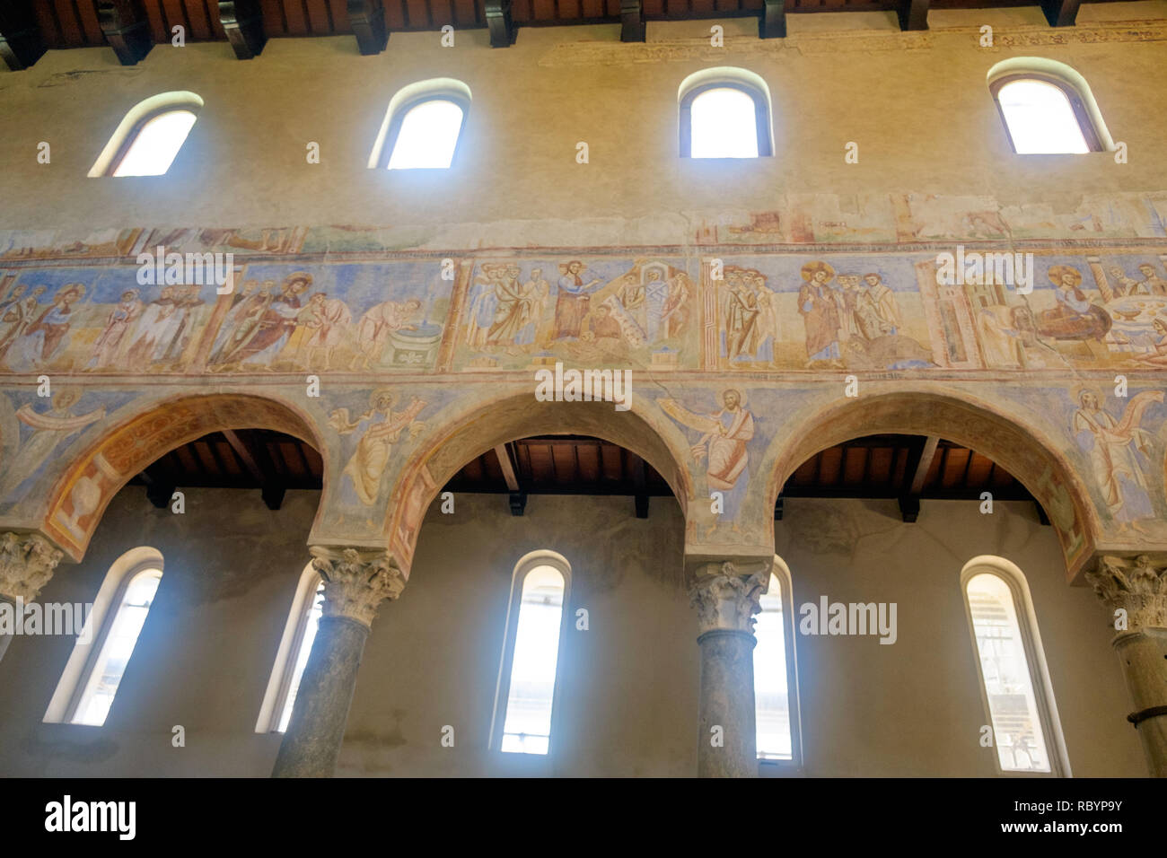 The church of Sant'Angelo in Formis is of particular historical value and was built in the 11th century. Here, you see columns and impressive frescos. Stock Photo