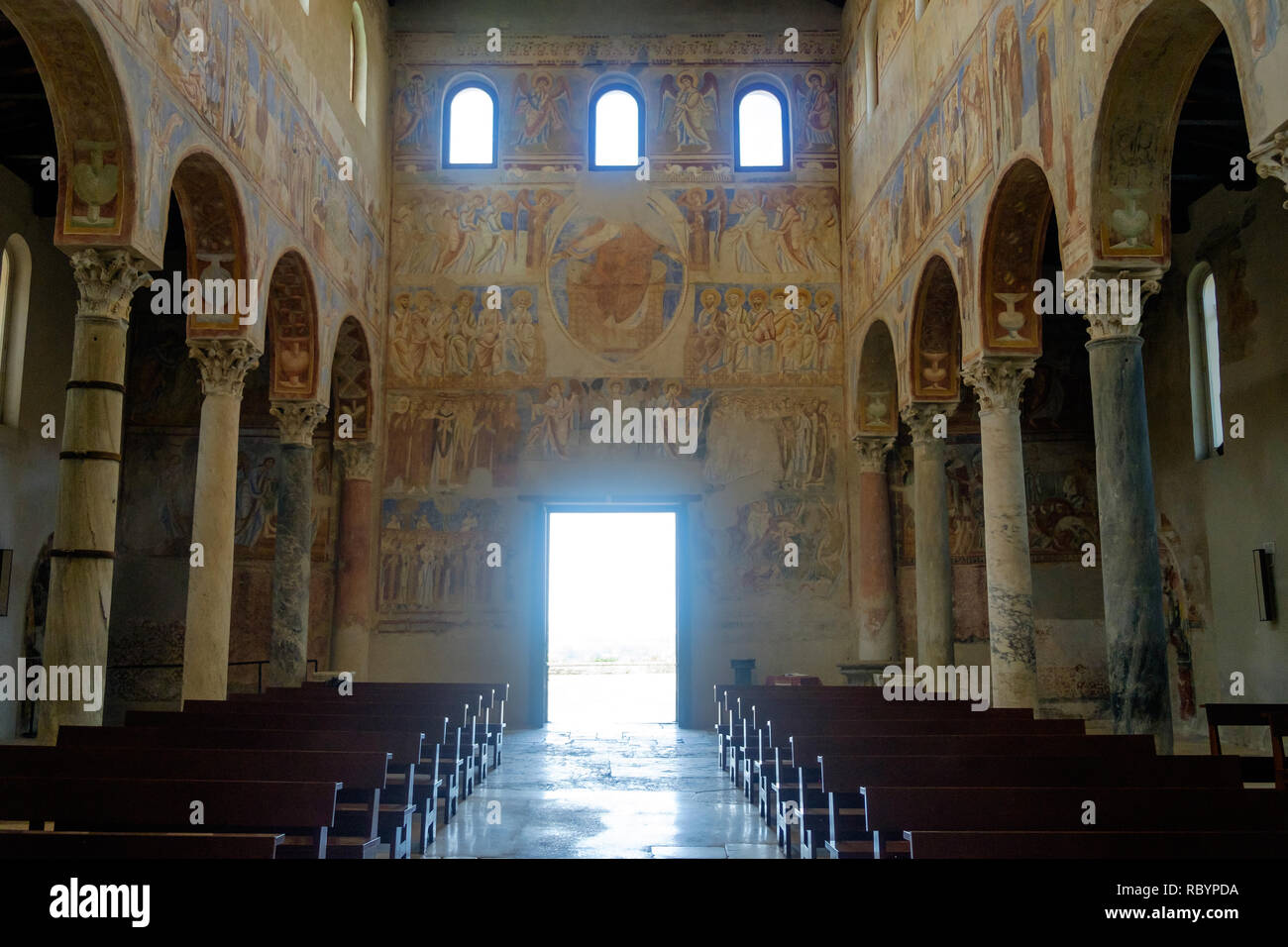 The basilica of 'Sant'Angelo in Formis' is of particular historical value. When looking outside, you get this impressive view with valuable frescos. Stock Photo