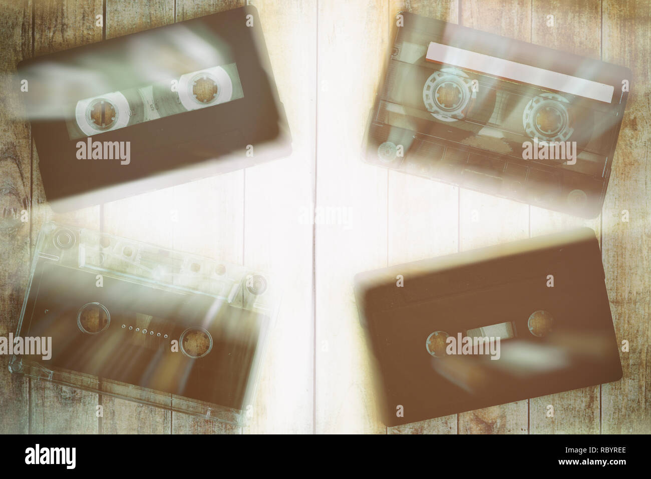 Old cassette tapes with a wooden background - Stock Image