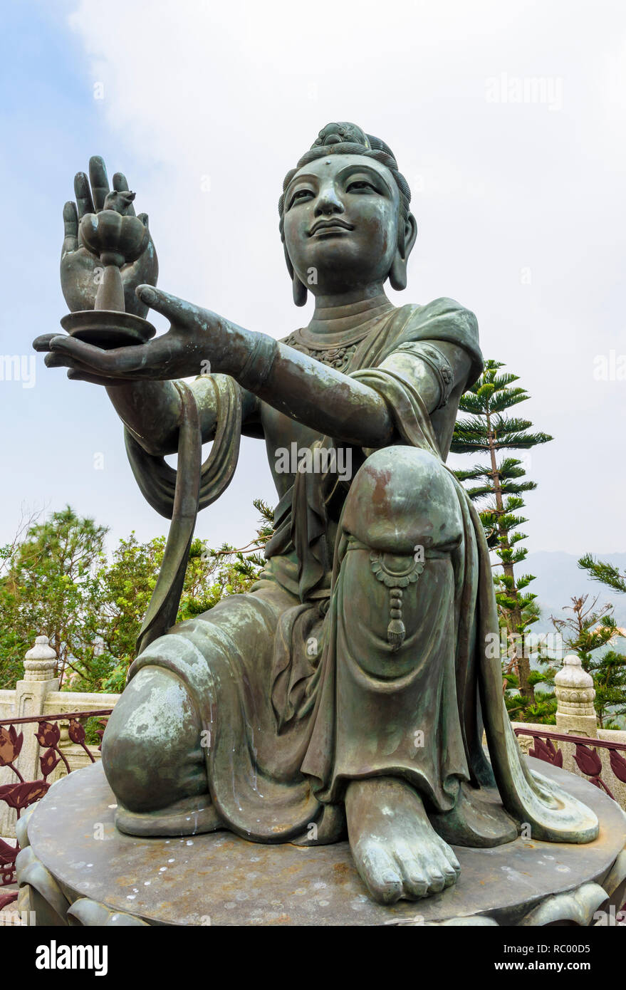 Statue of Buddhist saint making offerings to Buddha at the Tian Tan Buddha, Lantau Island, Hong Kong - Stock Image