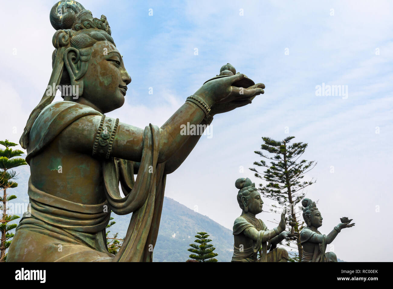 Statues of Buddhist saints making offerings to Buddha at the Tian Tan Buddha, Lantau Island, Hong Kong - Stock Image