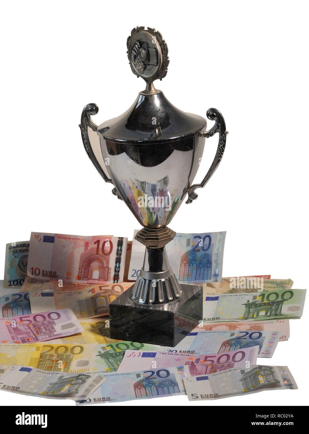 Geldscheine mit einem Pokal | Banknotes with a cup - Stock Image