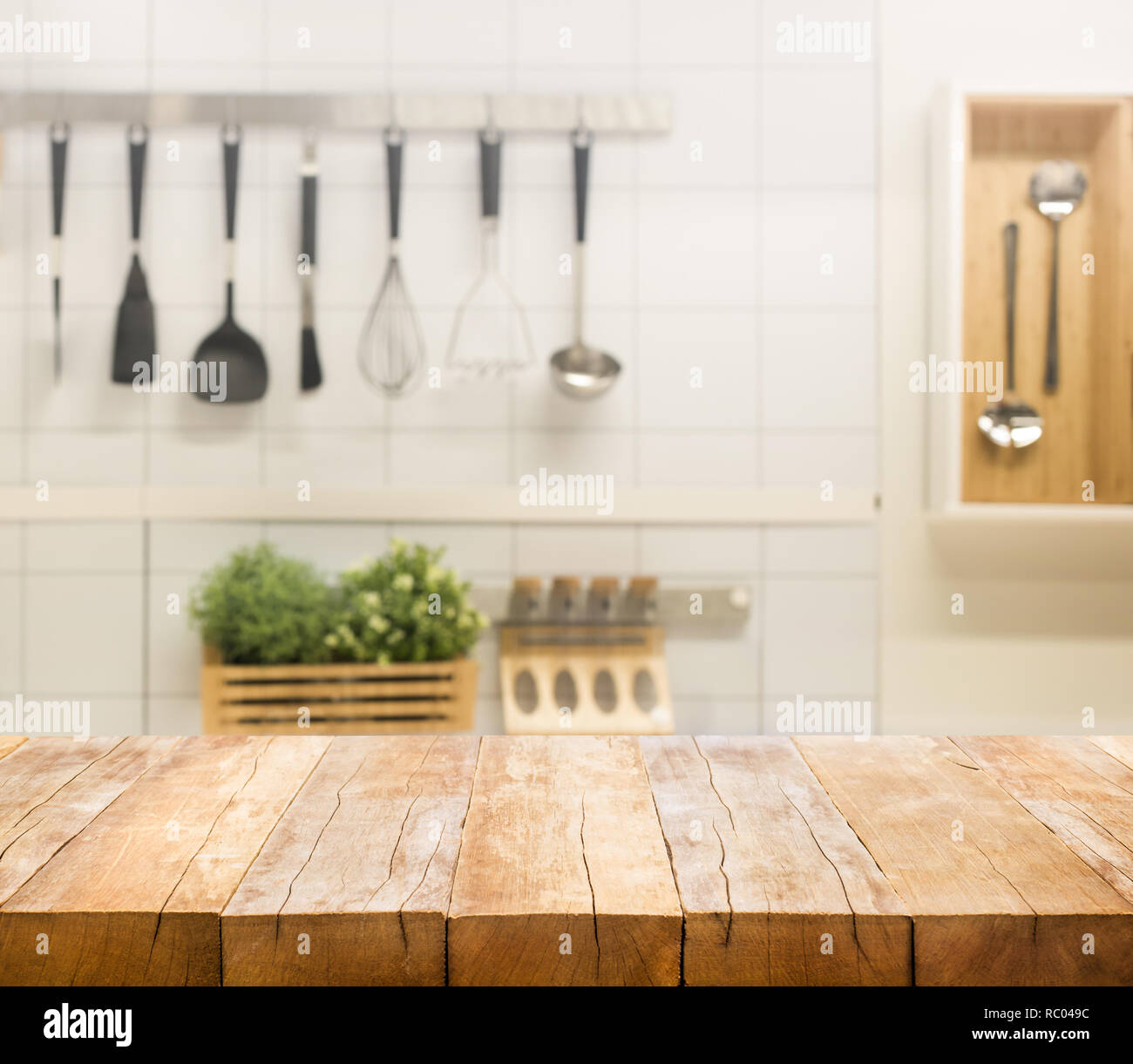 Wood table top on blur kitchen room background .For montage ...