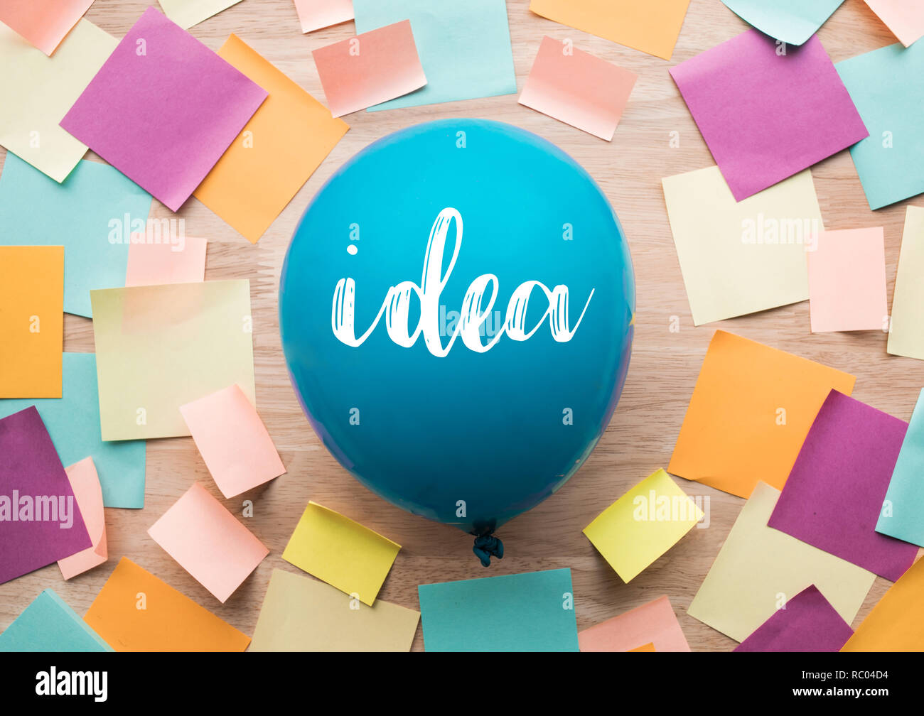 Inspiration ideas concepts with balloon and colorful notepaper on wood table.nobody - Stock Image