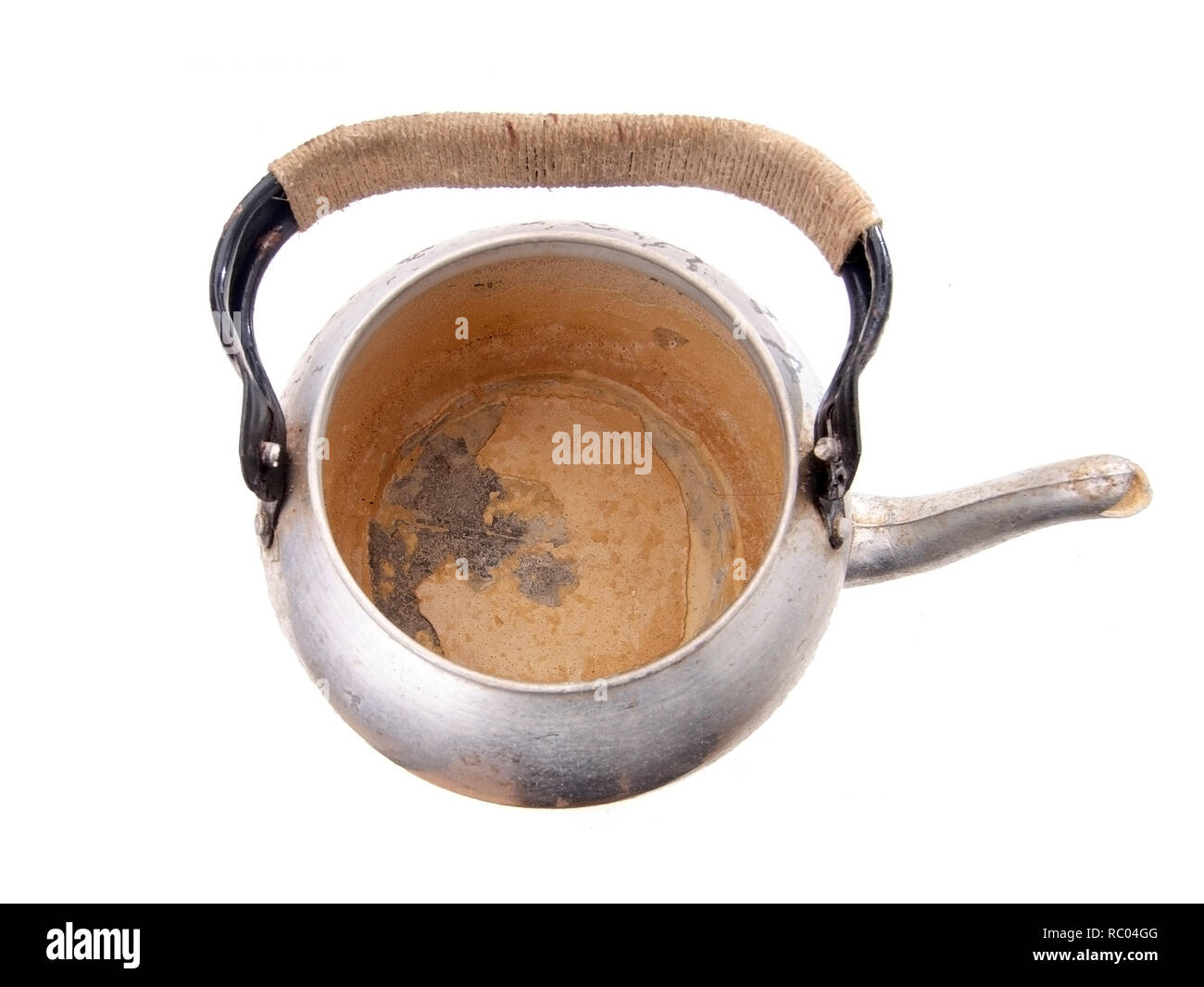 Limescale, scale in old kettle isolated on white. A white, chalky residue from deposit of calcium carbonate. Hard water problem. - Stock Image