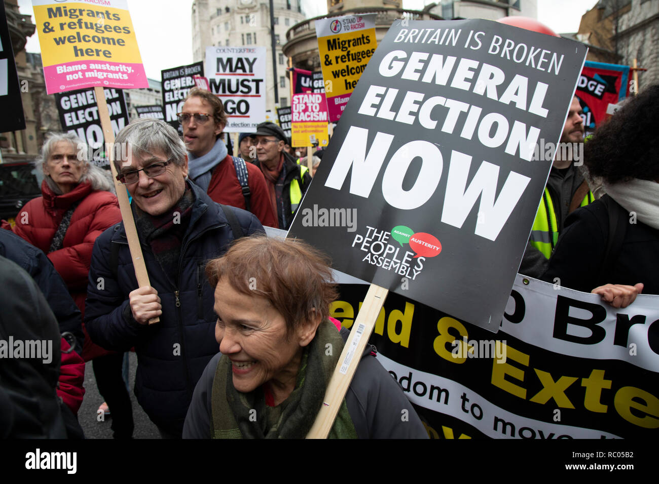Britain is Broken - General Election Now demonstration against Tory cuts and austerity on 12th January 2019 in London, United Kingdom. Irrespective of which way people voted in the EU referendum, this protest was calling for an end to austerity and homelessness, the nationalisation of rail and other utilities, and ultimately, for a general election to end the Tories power. Theresa May must go placard. - Stock Image
