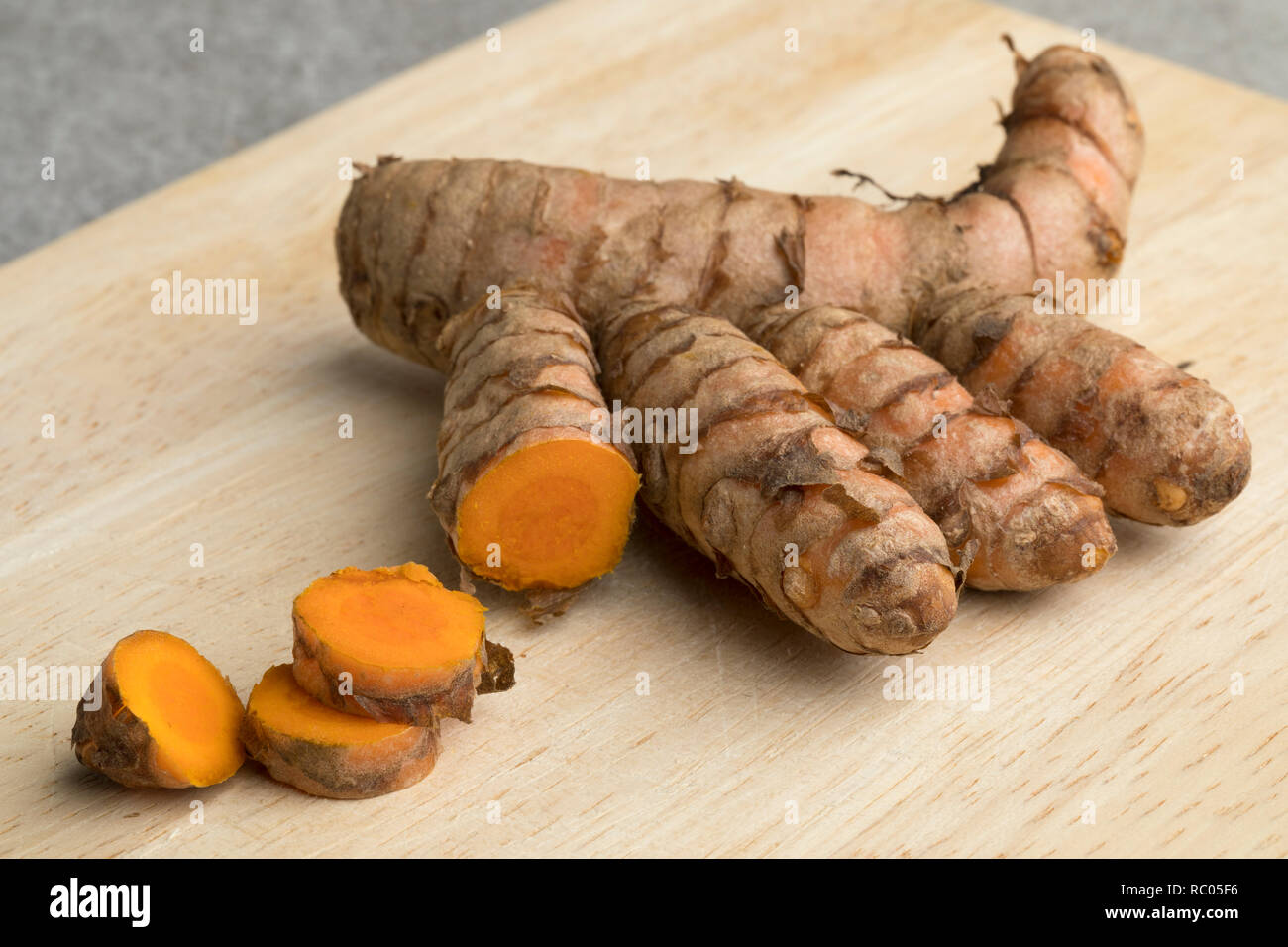Fresh raw curcuma rhizome and slices close up - Stock Image