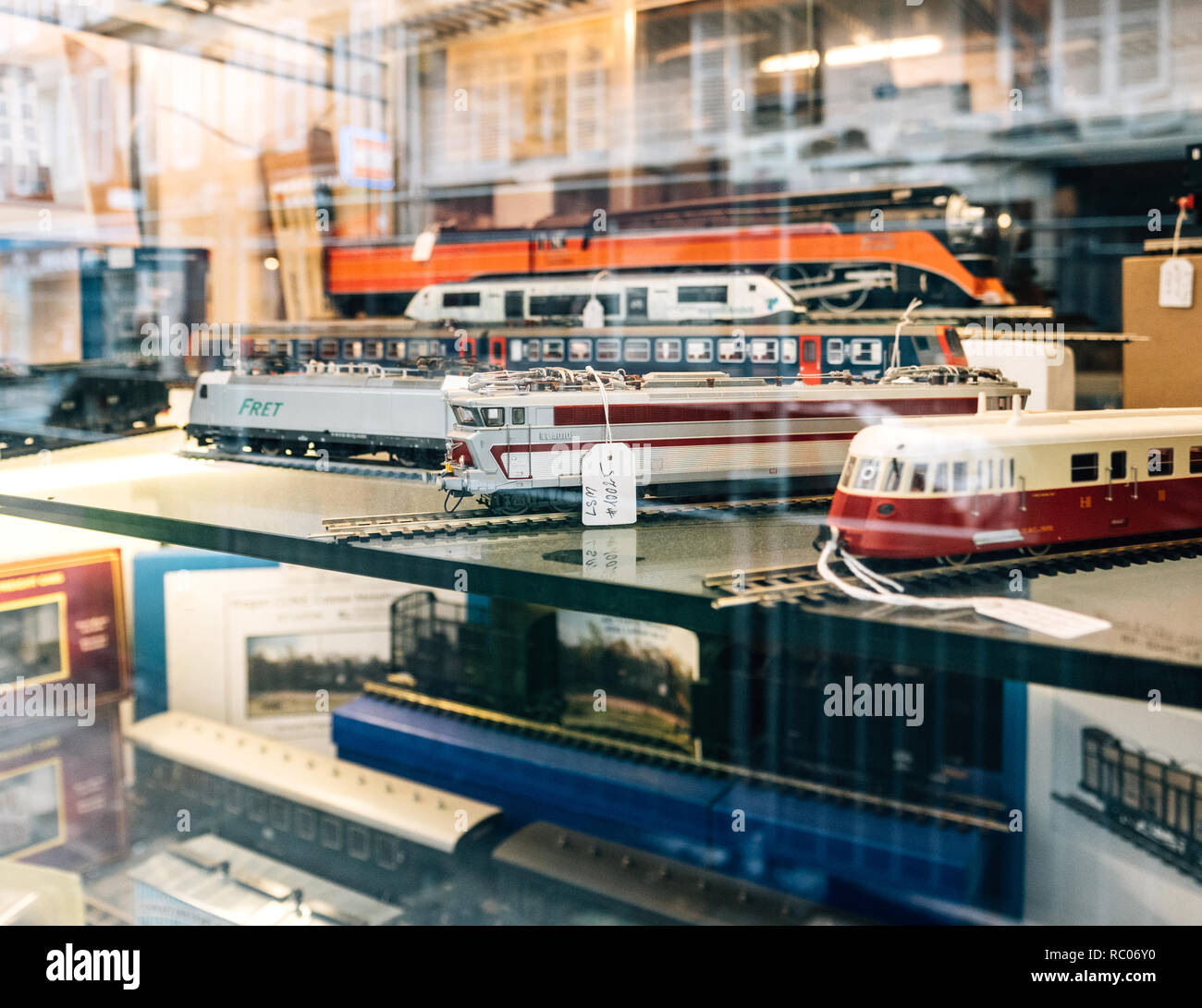 PARIS, FRANCE - JAN 30, 2018: Store window facade selling multiple toy collectible model trains featuring all railways in the world in central Paris, France - Stock Image