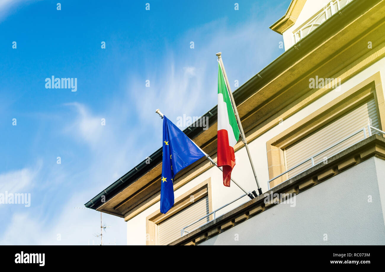 Italian and European union flags on the Embassy building on a sunny day in Strasbourg, France - Stock Image