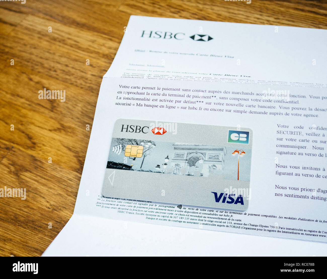 PARIS, FRANCE - JAN 26, 2017: New Contactless HSBC Visa banking card reception mail welcome on wooden table Stock Photo