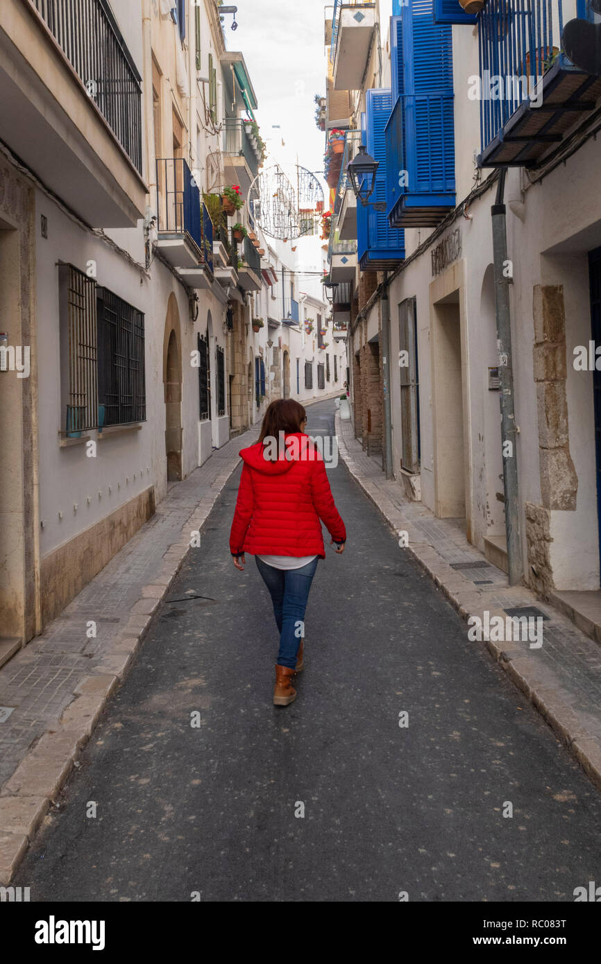 Walk through the beautiful streets of Sitges. - Stock Image