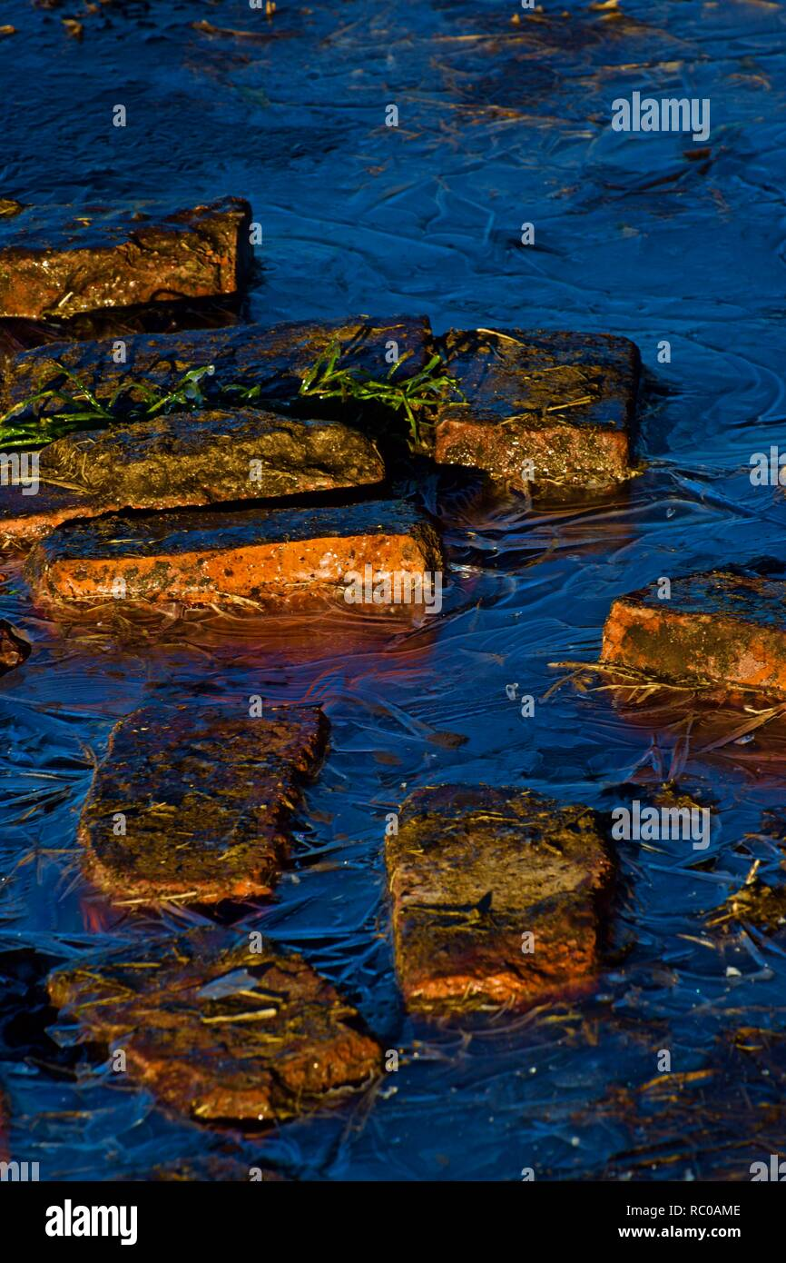 Red Bricks in Ice Still Life, Canyon, Texas - Stock Image