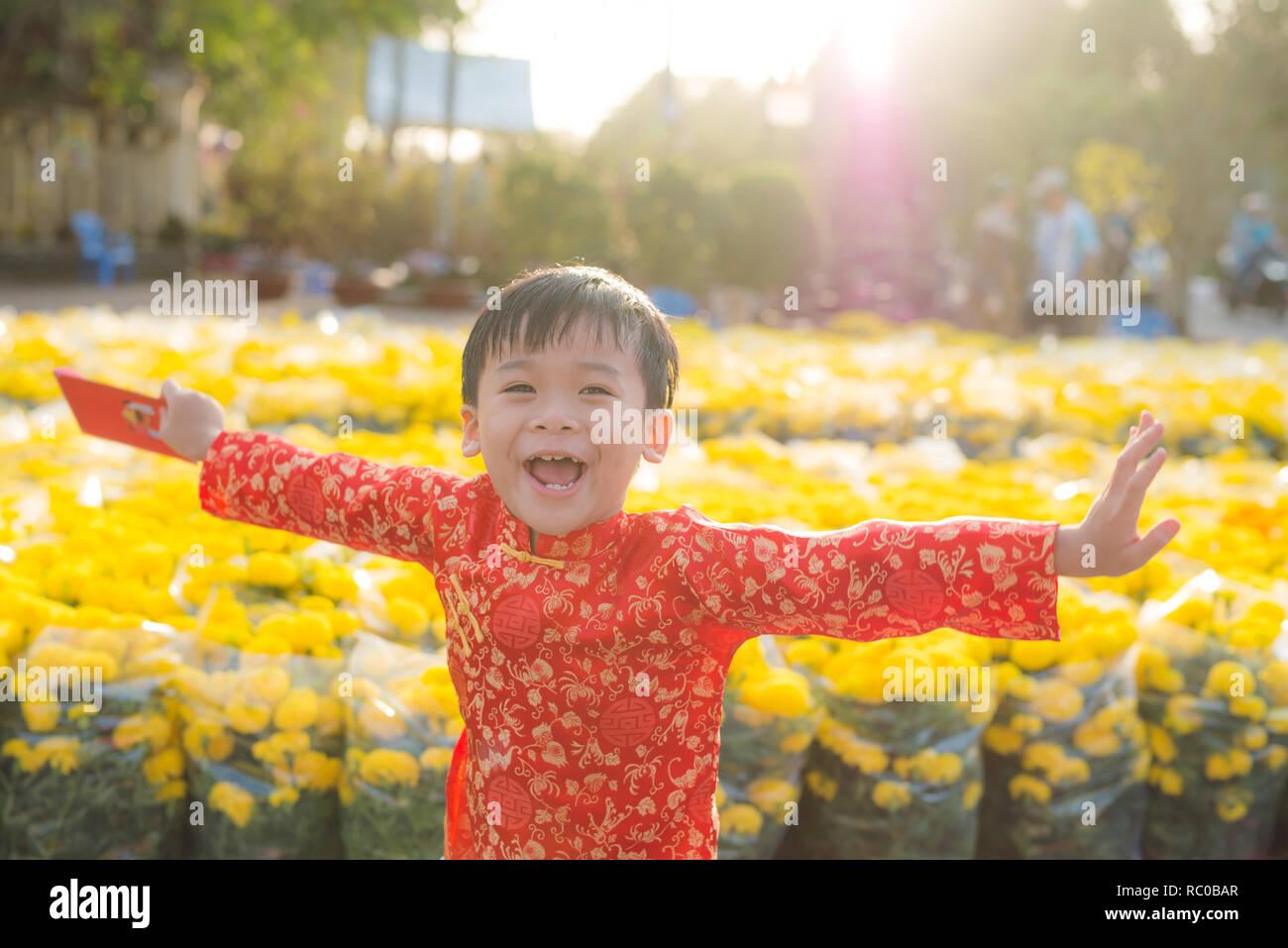 0399135b7 Portrait of a Asian boy on traditional festival costume. Cute little  Vietnamese boy in ao