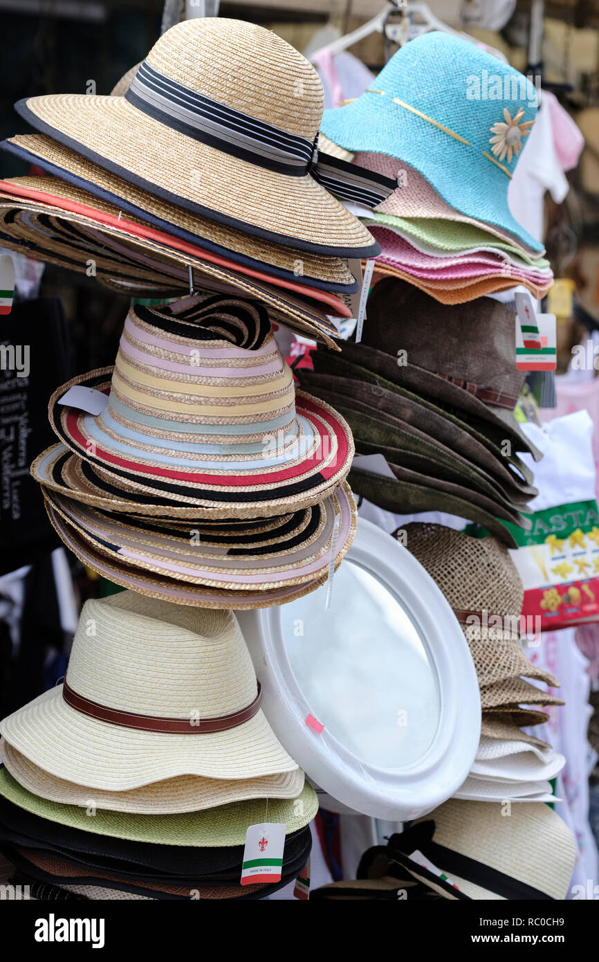 87e0fca577ae87 Various hats for sale on market stalls, Pisa, Tuscany, Italy, Europe ...
