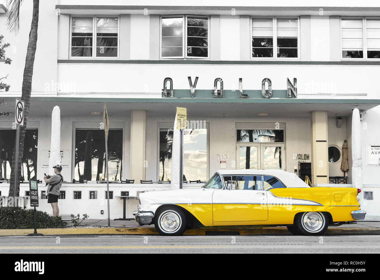 25 December 2019 - South Beach Miami, USA. Classic 1955 Oldsmobile Super 88 convertible in yellow parked near Avalon Art Deco hotel. - Stock Image