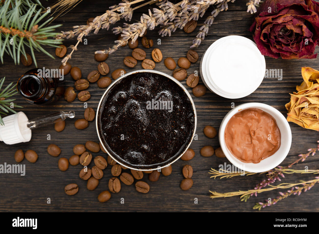 Aromatic botanical cosmetics. Dried herbs flowers mixture, aromatic homemade scrub paste made from coffee grounds and oils. Holistic herbal DIY skinca Stock Photo