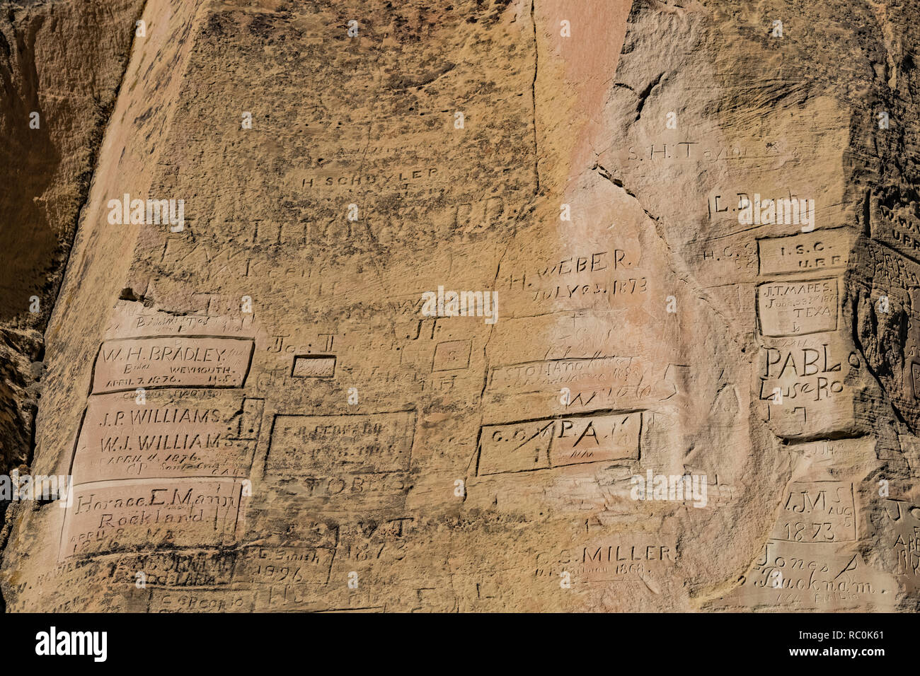 Names of wagon train and other emigrants carved into Inscription Rock in El Morro National Monument, New Mexico, USA - Stock Image