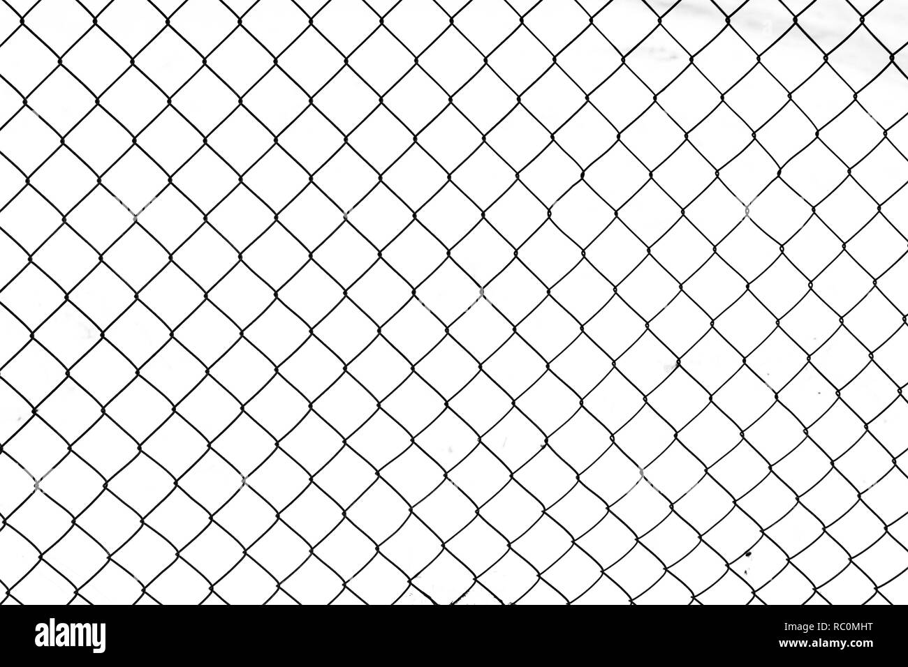 Wire fence in the snow. Black and white abstract backgraund. - Stock Image