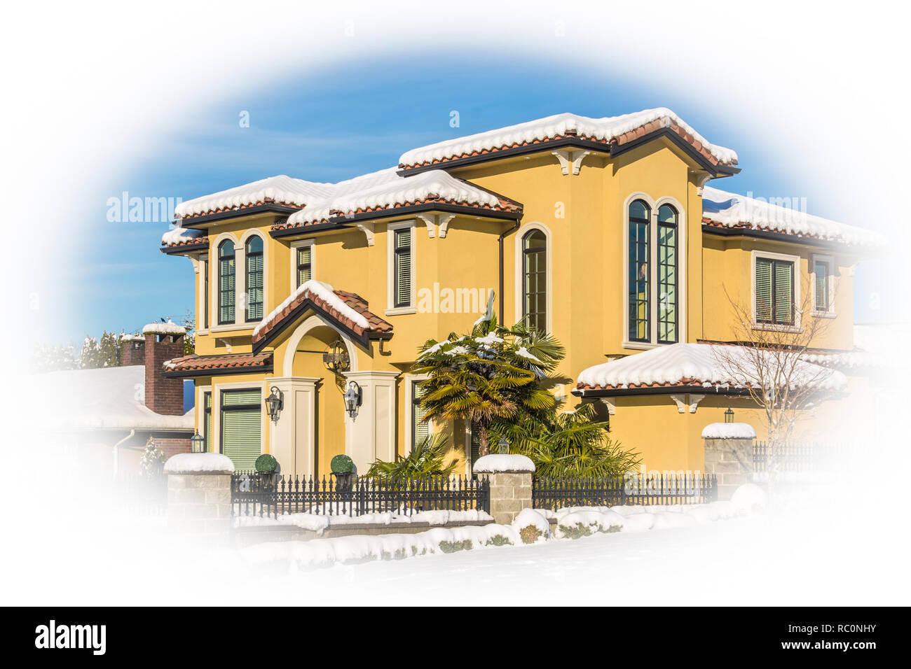 Luxurious residential house in snow on winter sunny day in Canada - Stock Image
