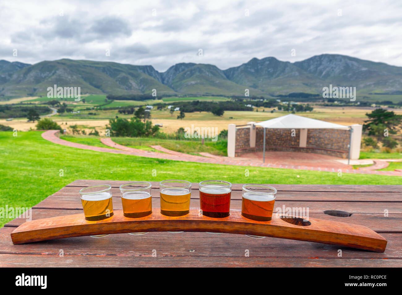 Beer Tasting Glasses On A Wooden Tray Outside The Brewery With A