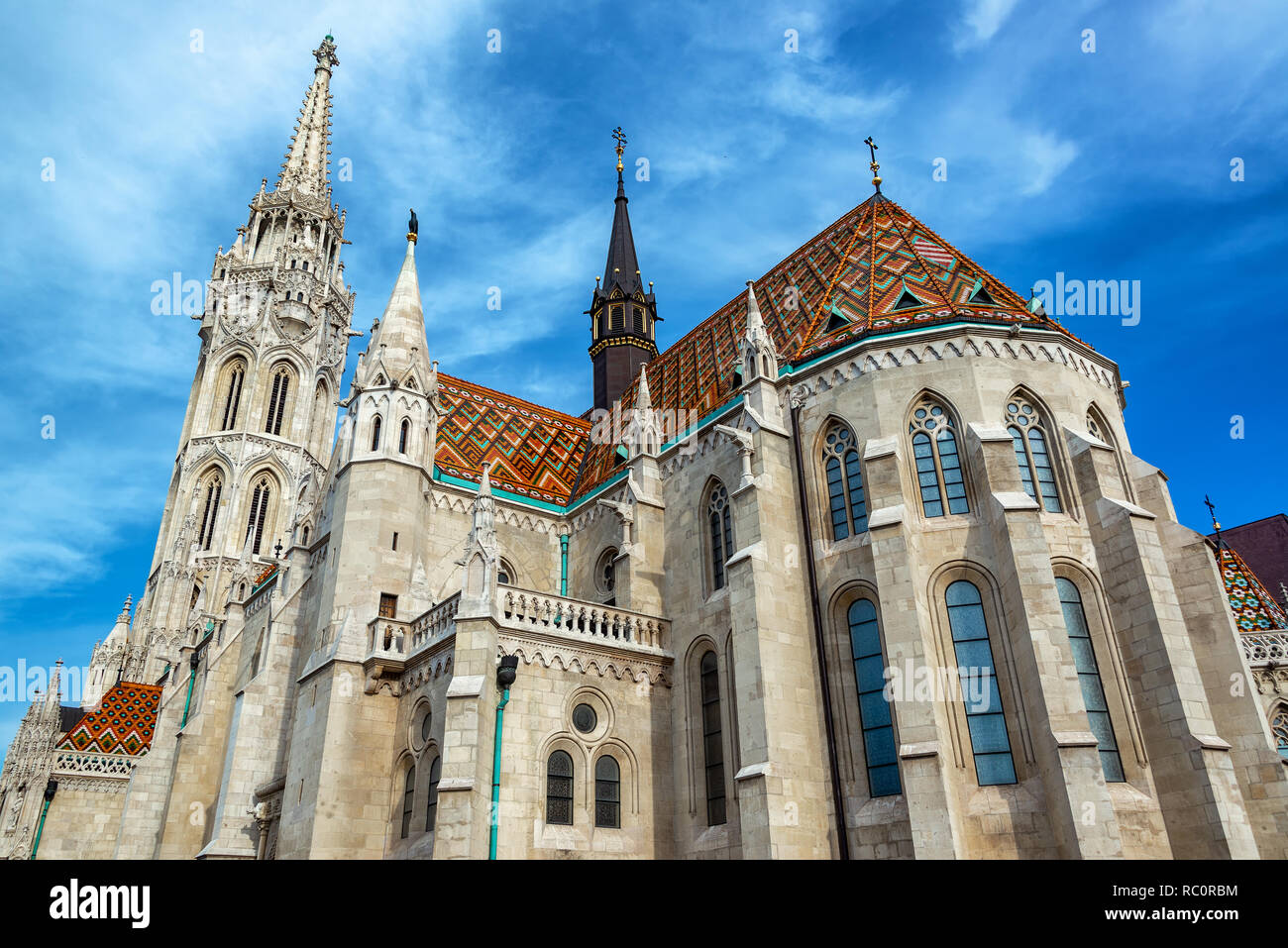 St. Matthias church with a beautiful blue sky at Fishermans Bastion in Budapest, Hungary - Stock Image