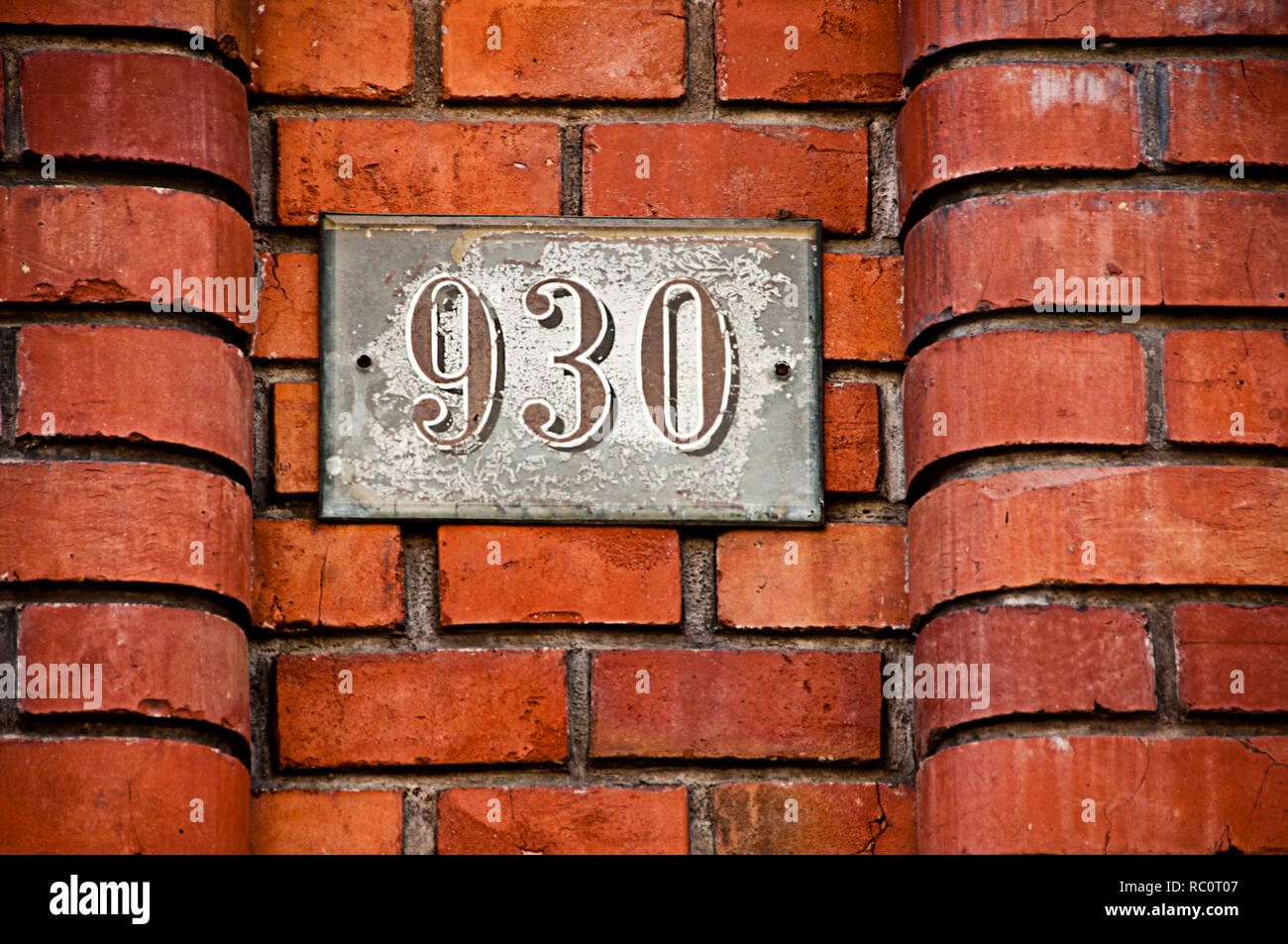 number  930 - house numbering plate Stock Photo