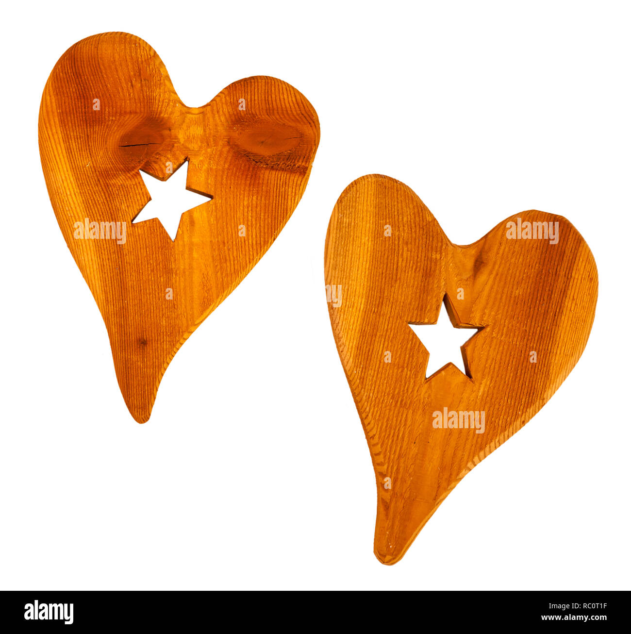 Two big wooden hearts sawn with stars in the middle - Stock Image