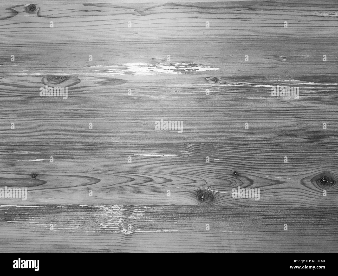 brown wooden texture background, dark oak of weathered distressed washed wood with faded varnish paint showing woodgrain texture. wash hardwood planks - Stock Image