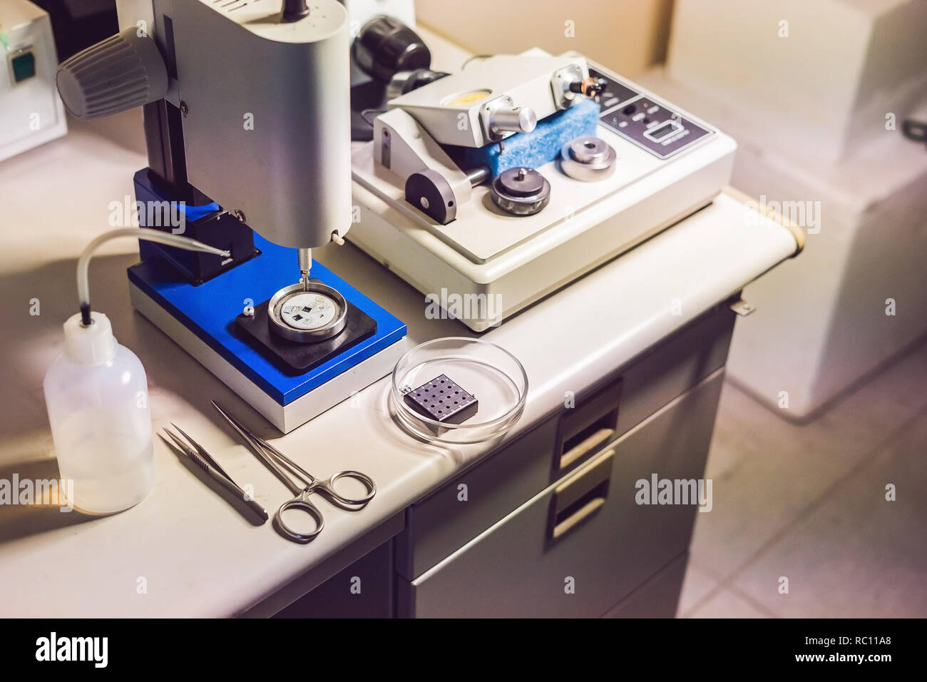 Ultrasonic Cutter System and precision micrometer grinder polishing machine used to prepare samples for electronic microscopy investigation - Stock Image